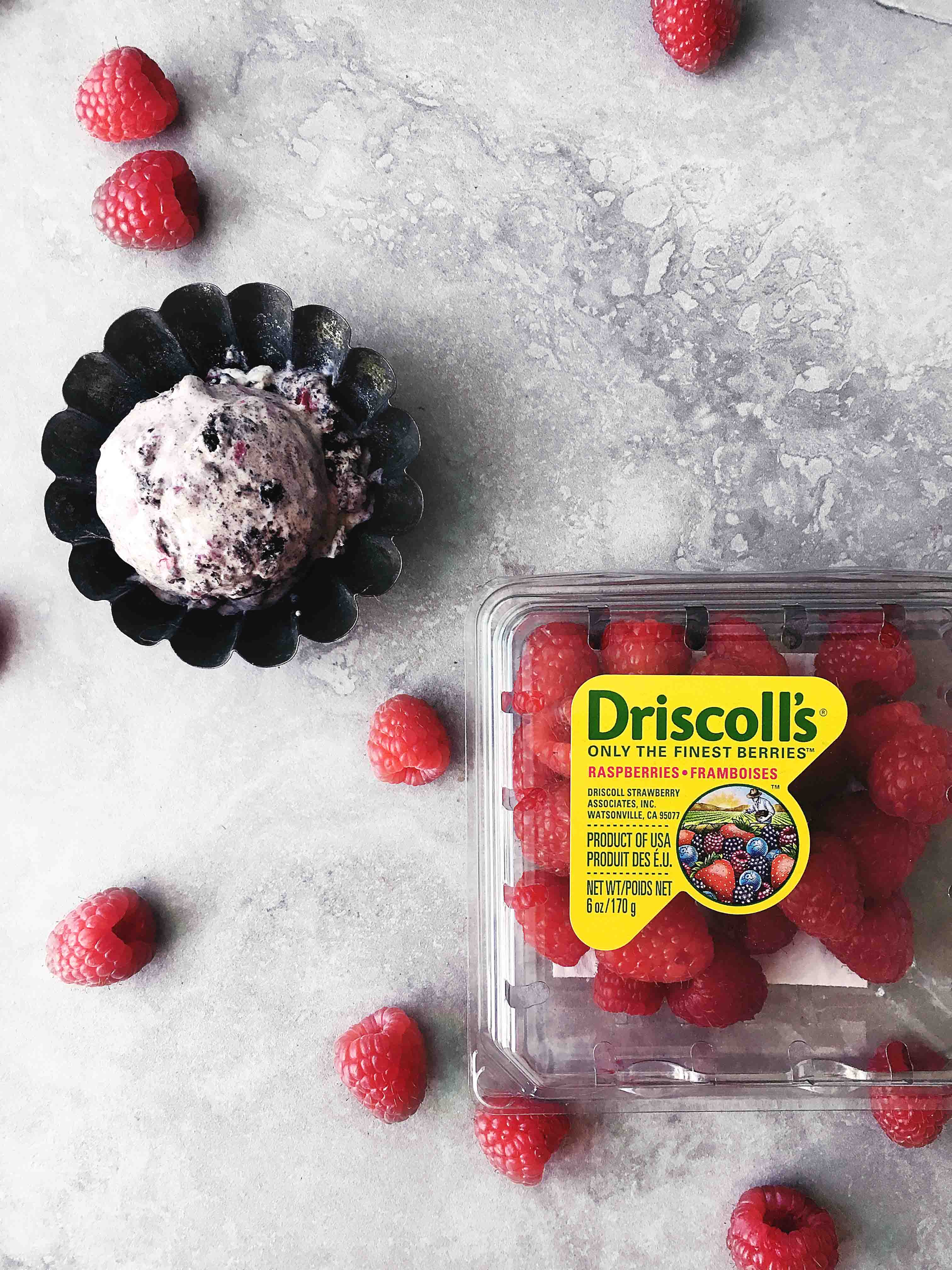 A no-churn cookies and cream ice cream studded with bright and juicy fresh raspberries