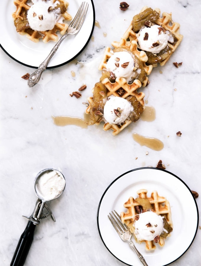 Bananas Foster Waffles made with vanilla ice cream, pecans, and caramelized rum bananas over a pillowy banana rum waffle. Yahm.