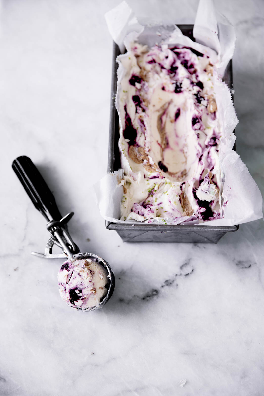 Let's give ice cream season one last hurrah: lime cheesecake ice cream swirled with sautéed lime zested blueberries and almond butter. DROOL.