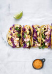 Coconut Salmon Tacos marinaded in coconut milk, lime, and ginger, complete with a homemade jalapeño pineapple salsa & sriracha mayo. A total hit for your next Taco Tuesday.