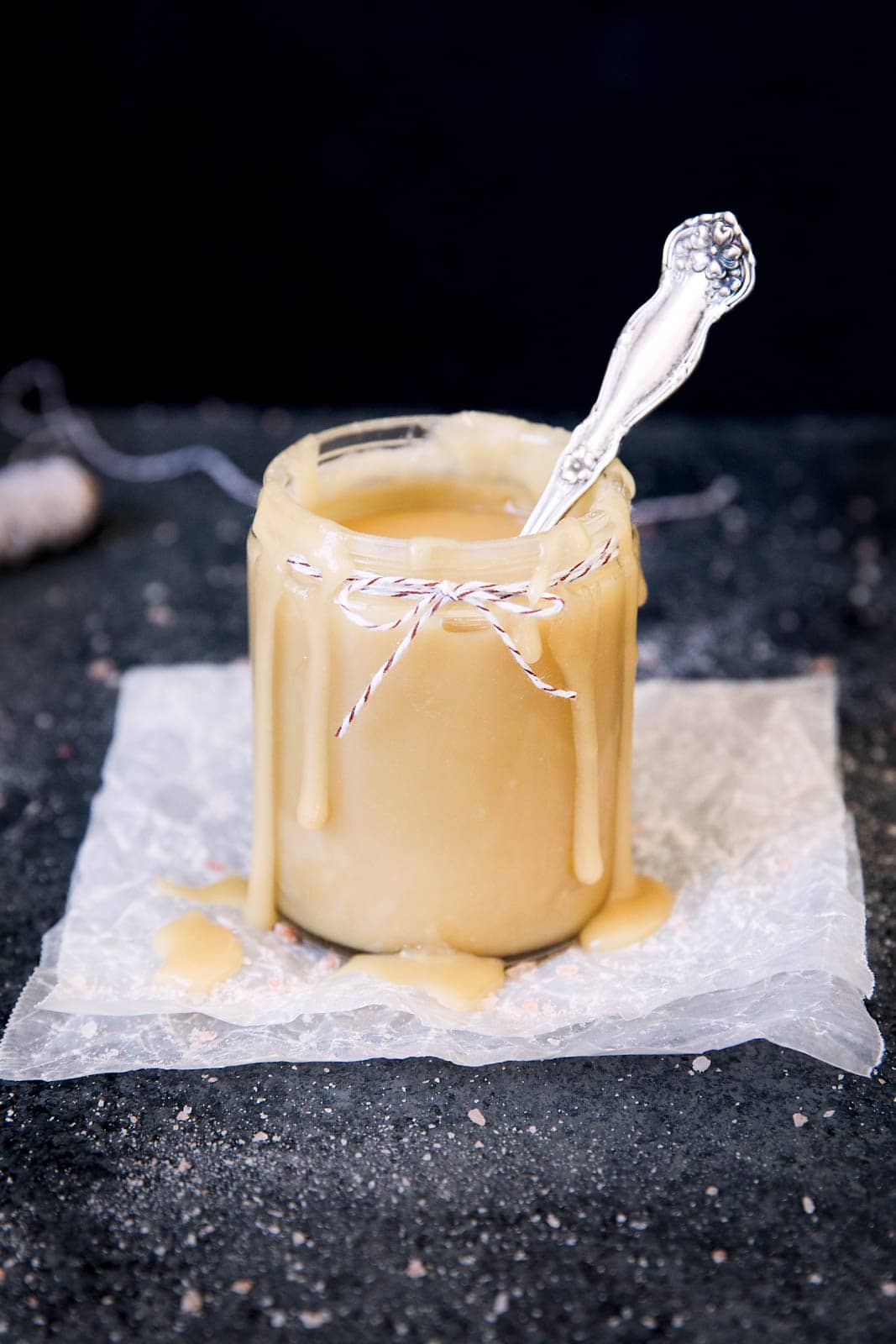 maple salted caramel sauce in a jar with spoon