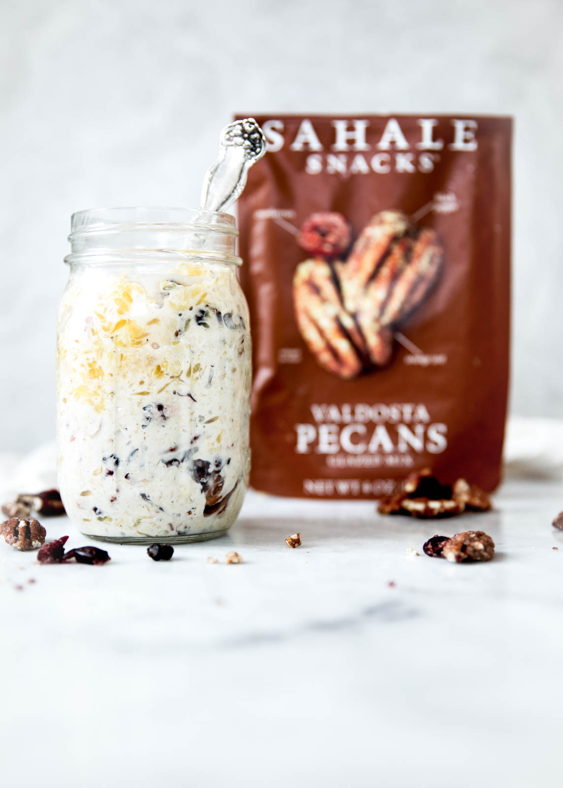 Overnight oats are a simple and nutritious breakfast all year round. This version, with dried cranberries, orange, and Valdosta pecans, is insanely delicious!