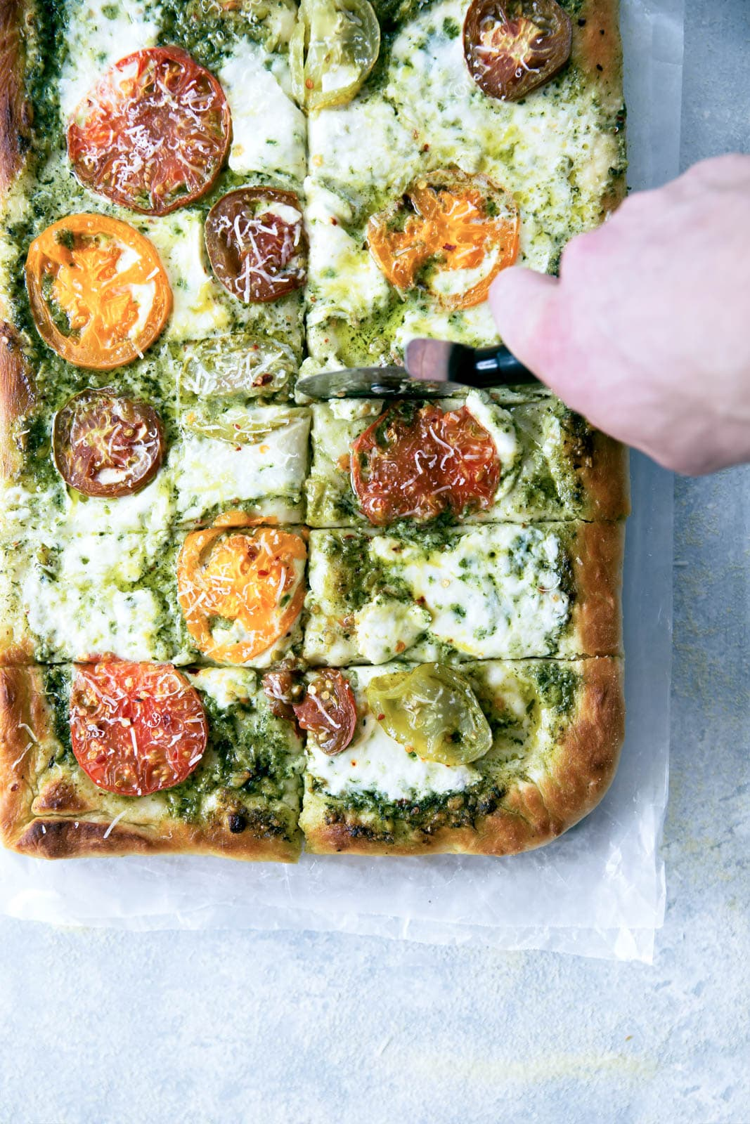 Say goodbye to heirloom tomato season with this ridiculously addicting heirloom tomato pesto pan pizza!