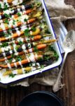 Cumin roasted carrots with tahini dressing are a perfect easy, delicious, and unique side for your holiday table!