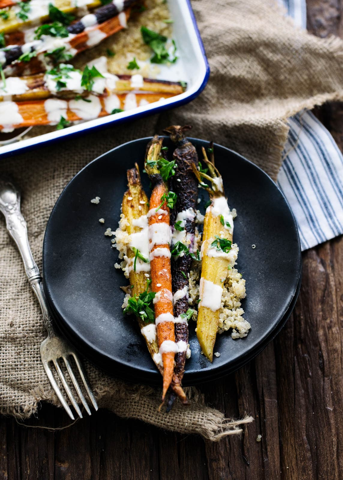 Cumin Roasted Carrots with Tahini Dressing on a plate