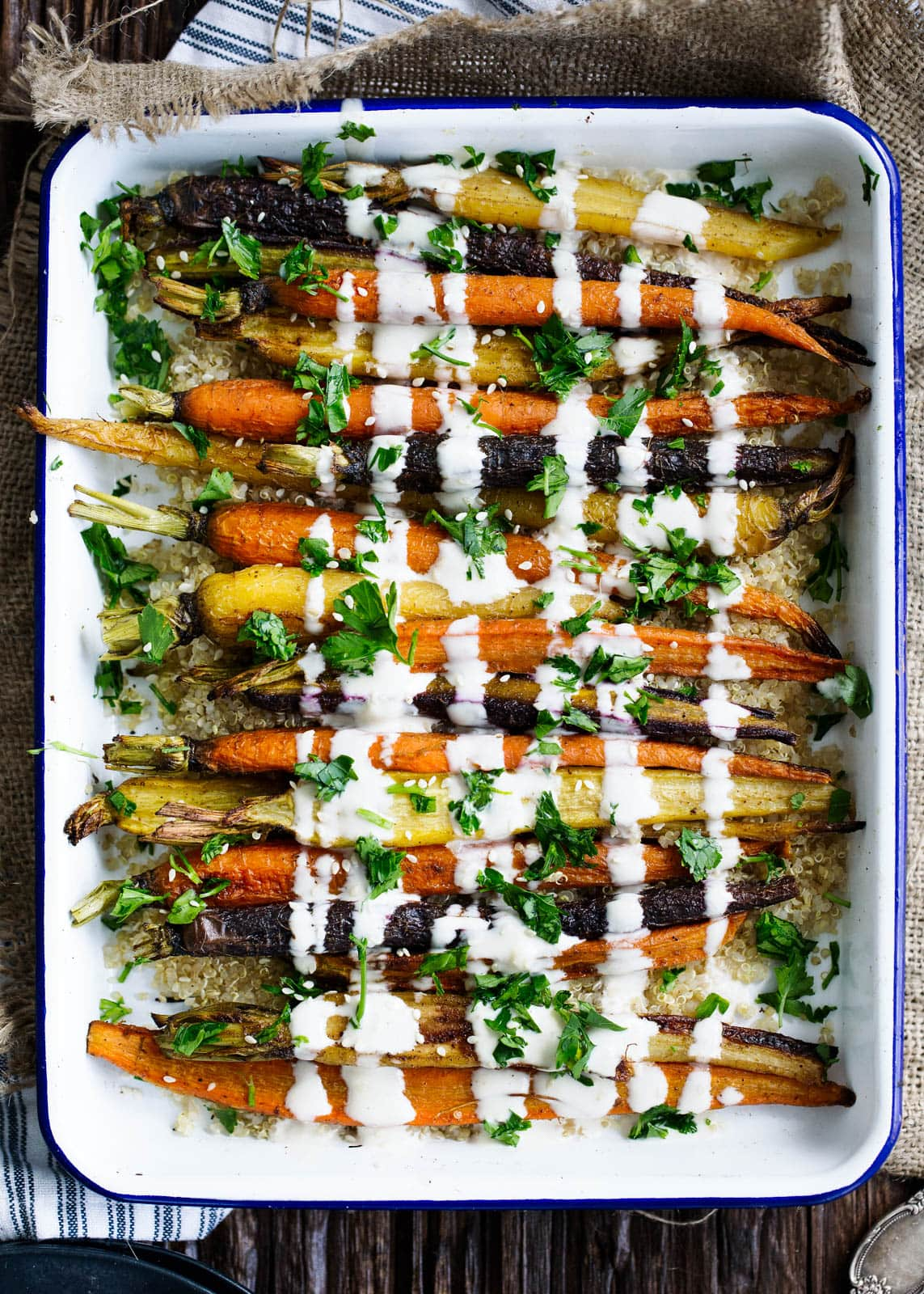 Cumin Roasted Carrots with Tahini Dressing in baking dish