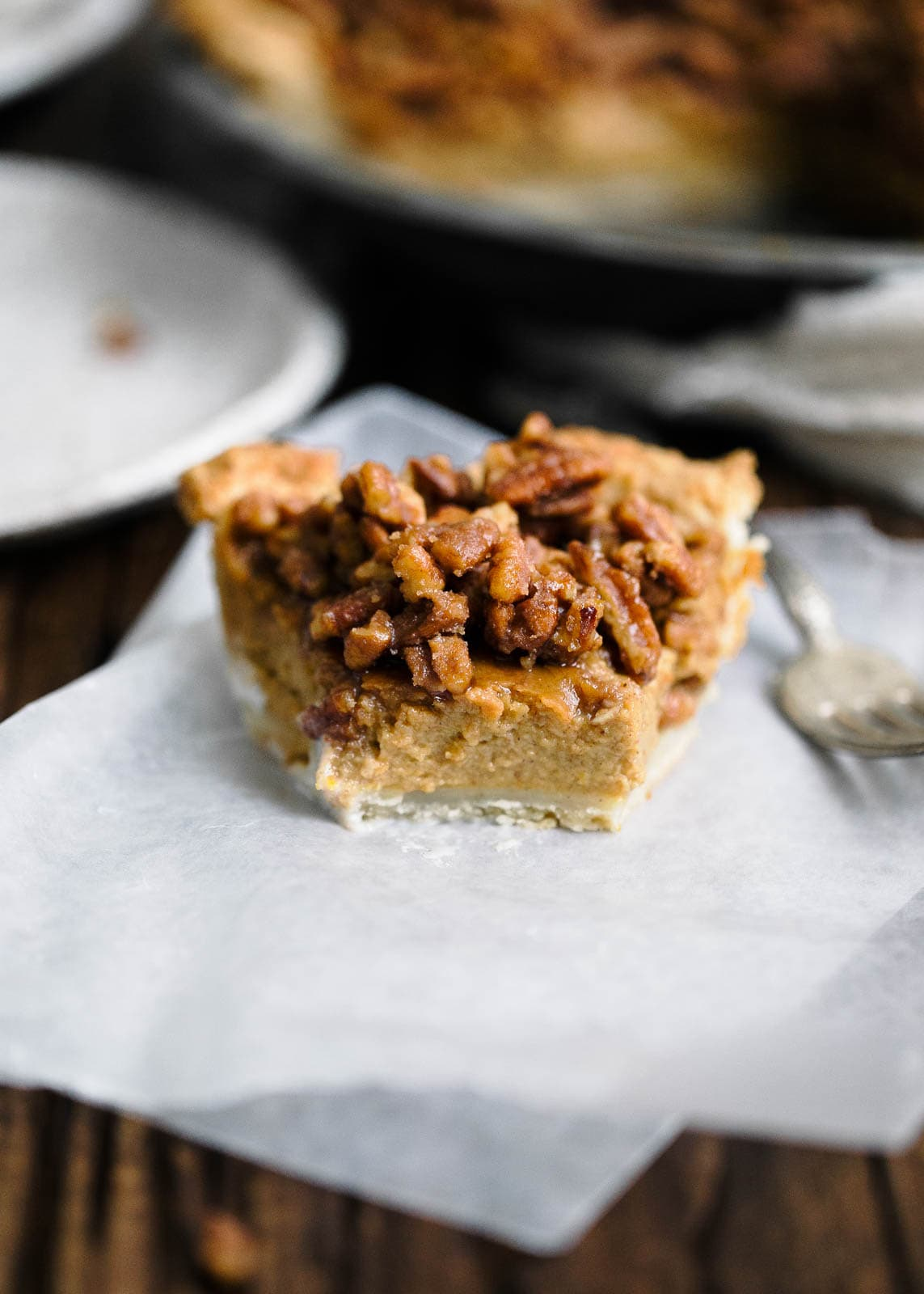 Maple Pecan Bourbon Pumpkin Pie slice on paper towel