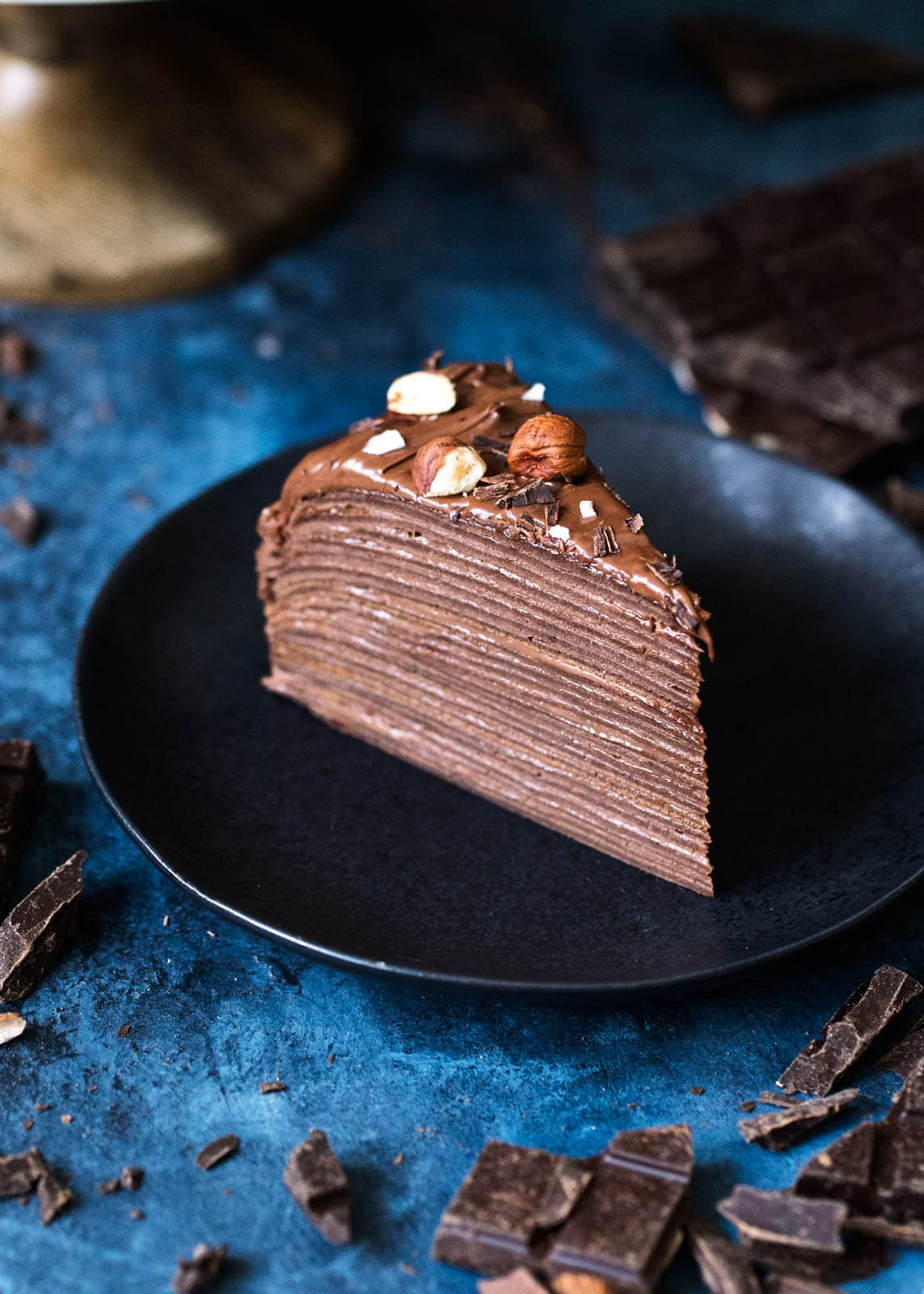 Hazelnut Chocolate Crepe Cake slice on a plate