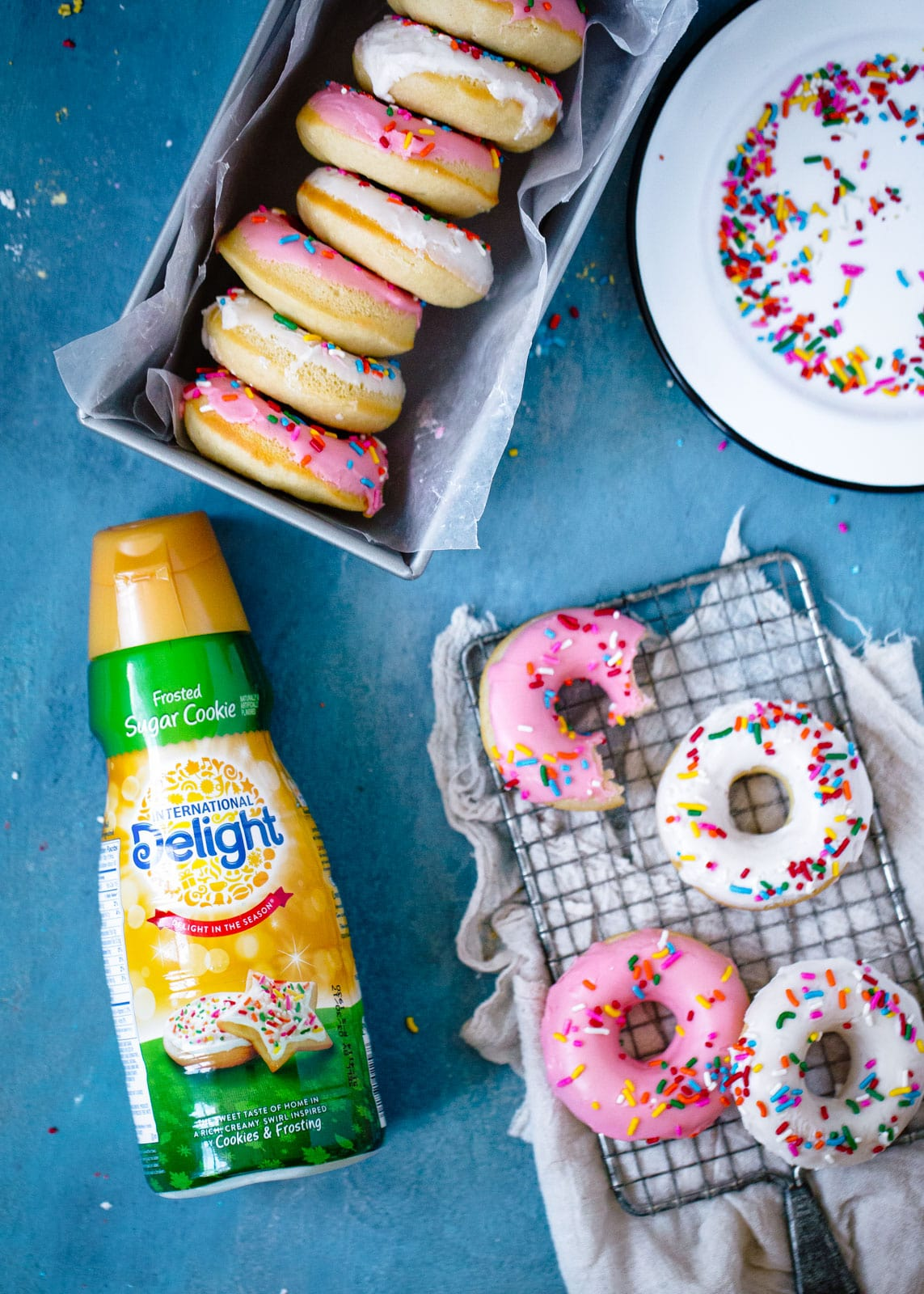 Frosted Sugar Cookie Donuts aka donuts that taste like classic frosted sugar cookies. AND THERE'S SPRINKLES.