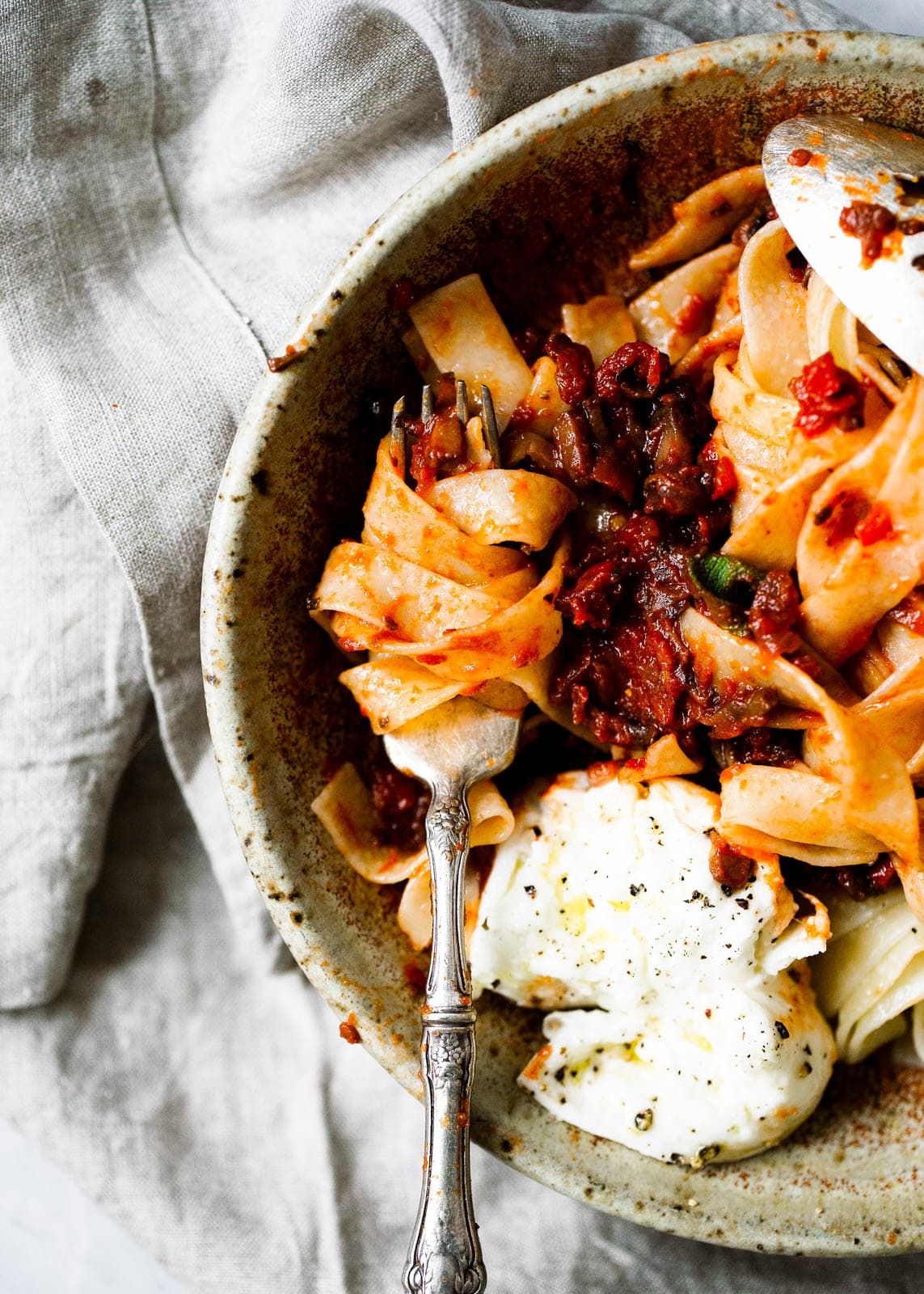 mushroom bolognese sauce on pasta with cheese