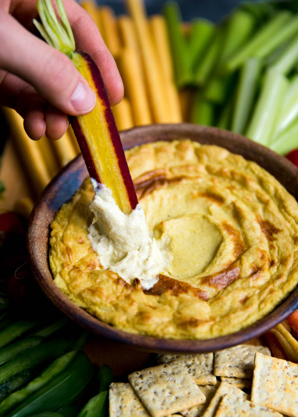 Mom's creamy, cheesy Artichoke Dip with a bountiful crudités is perfect for a crowd.