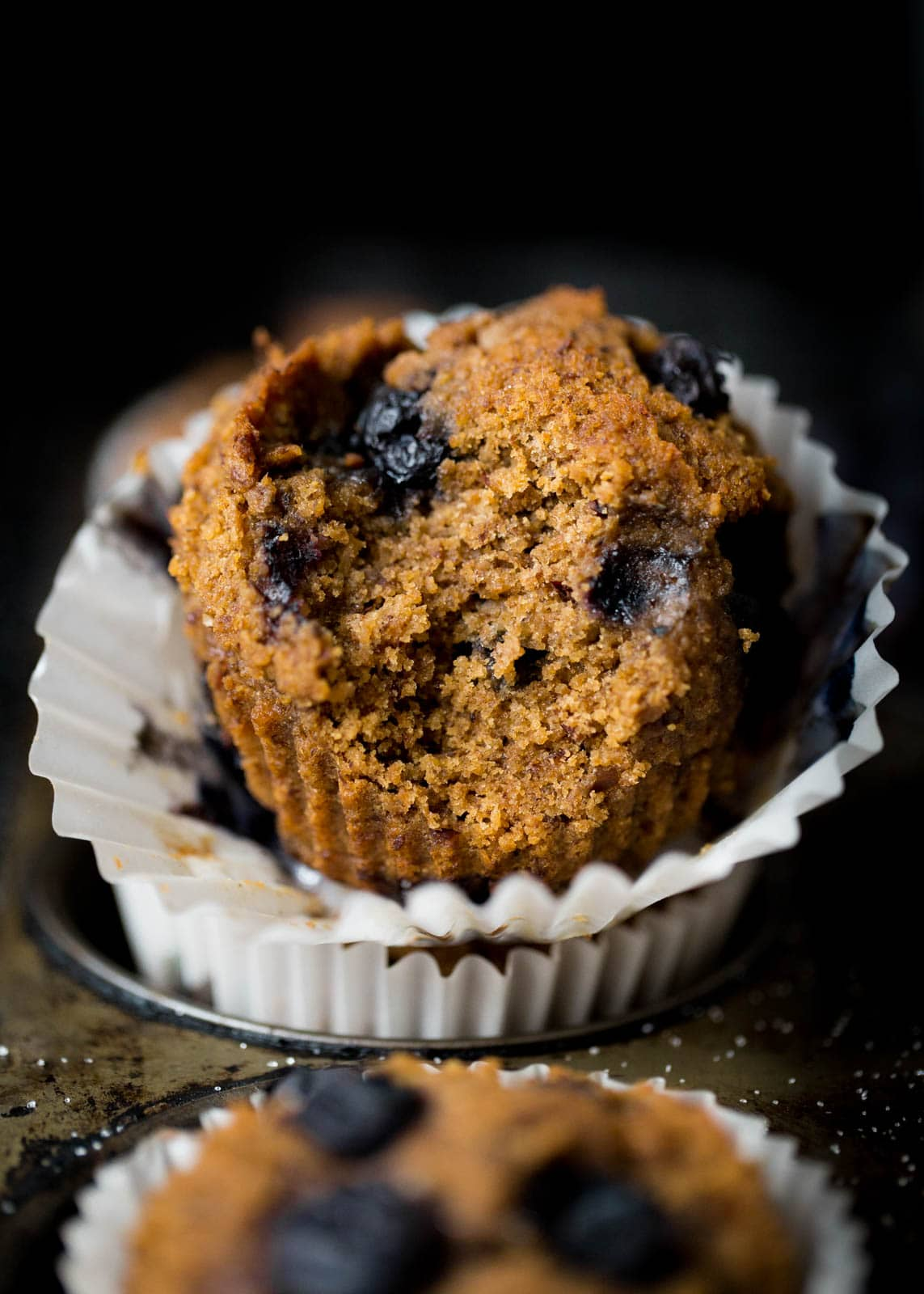 blueberry bran muffin with bite taken out