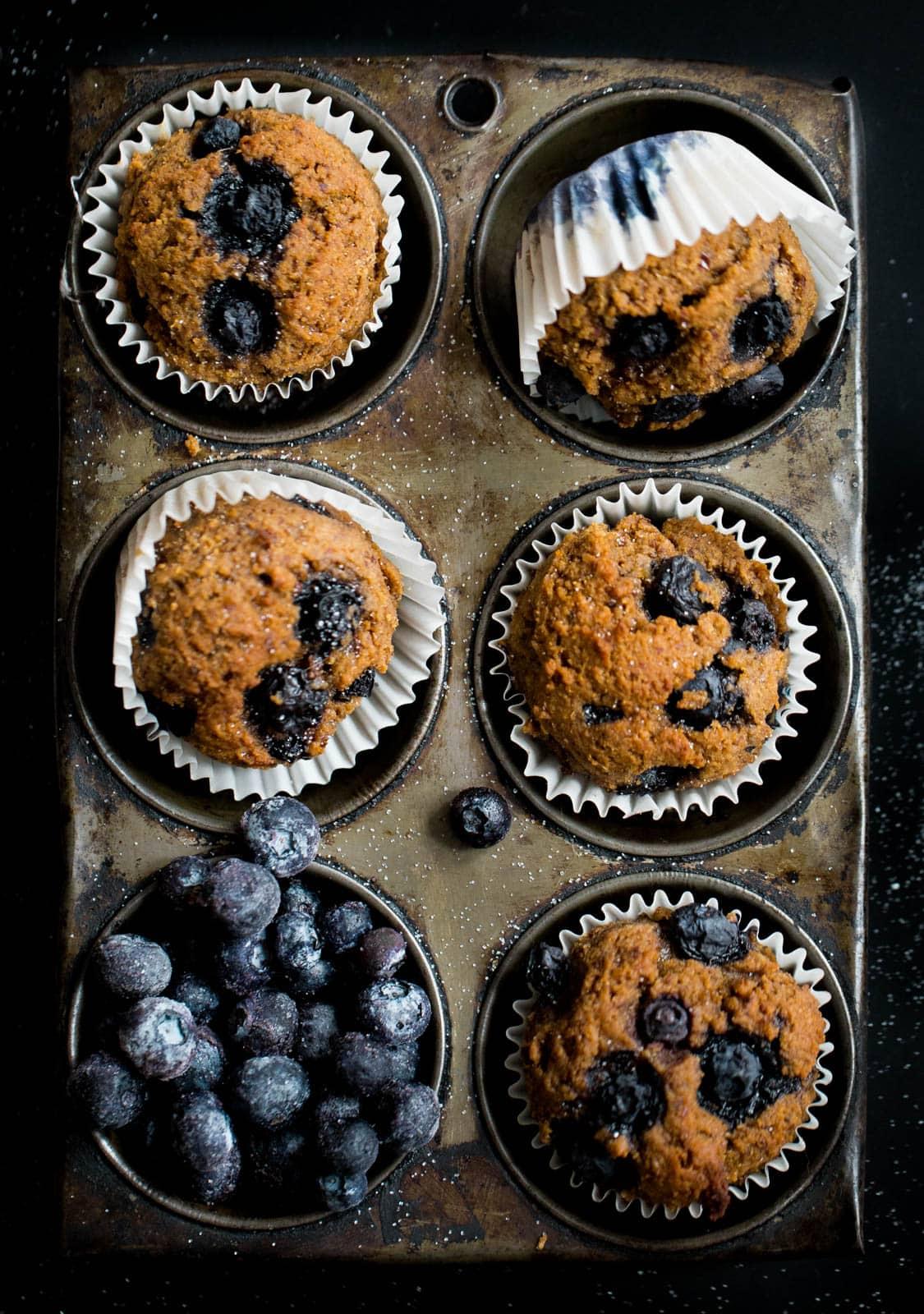 blueberry bran muffins in muffin tin