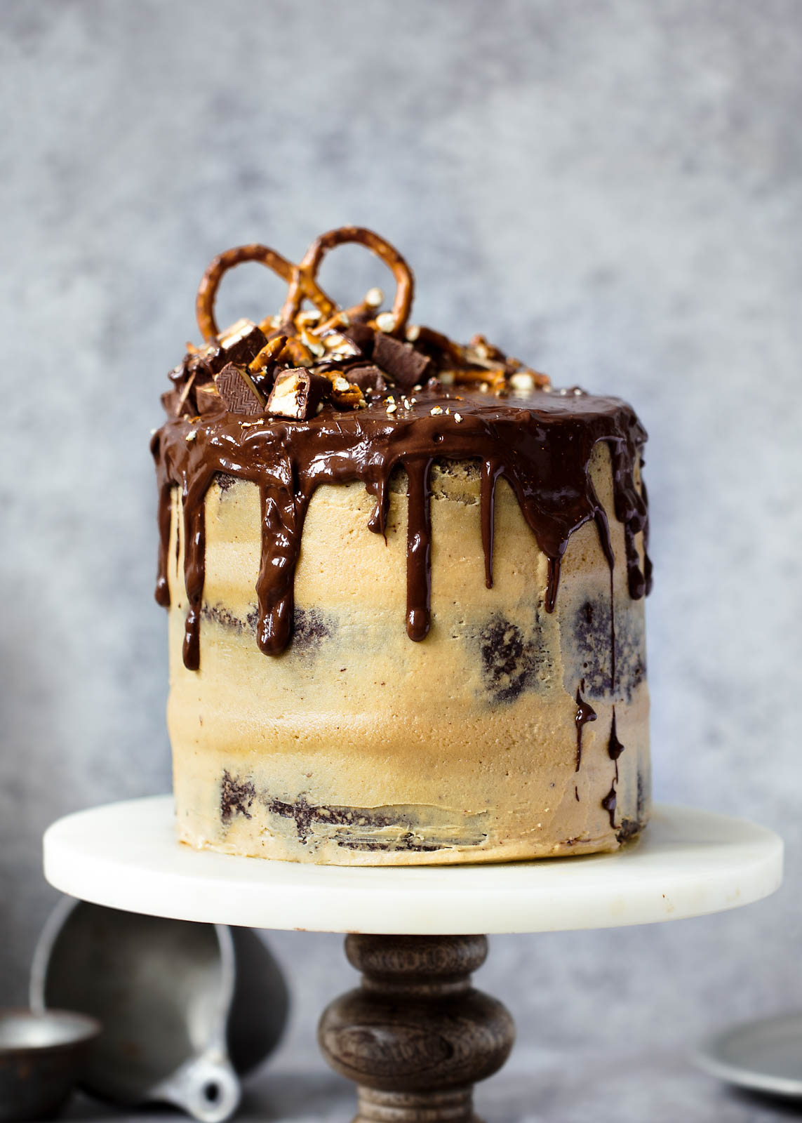 Peanut Butter Chocolate Stout Cake on cake stand