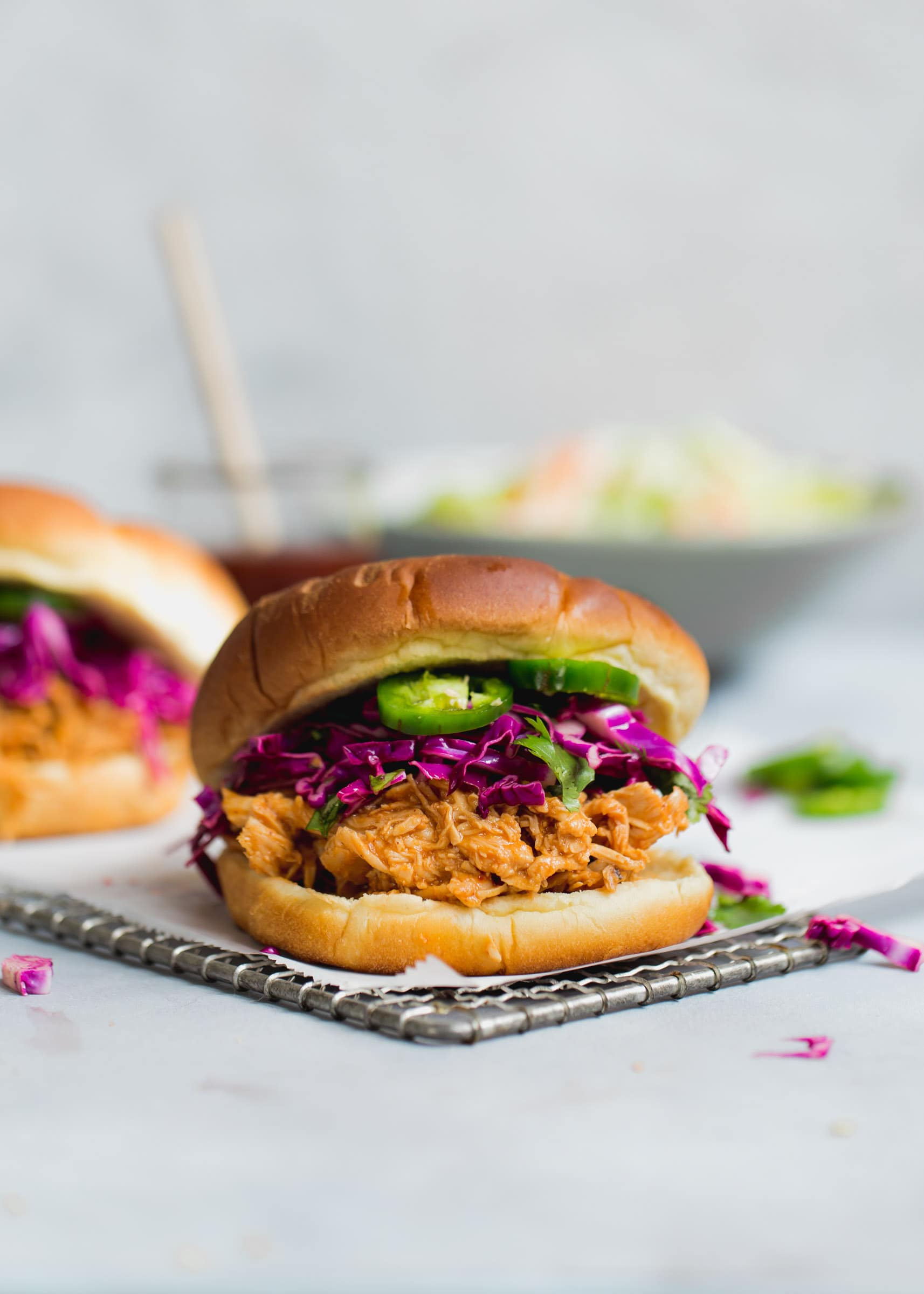 Slow Cooker Asian BBQ Pulled Chicken Sandwiches with a cilantro and purple cabbage slaw. No fuss and all flavor!