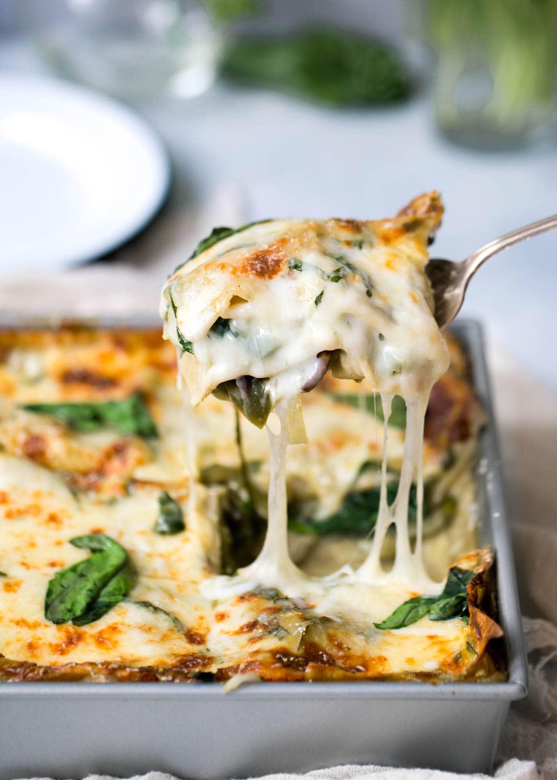 serving a slice of Vegetarian Green Lasagna