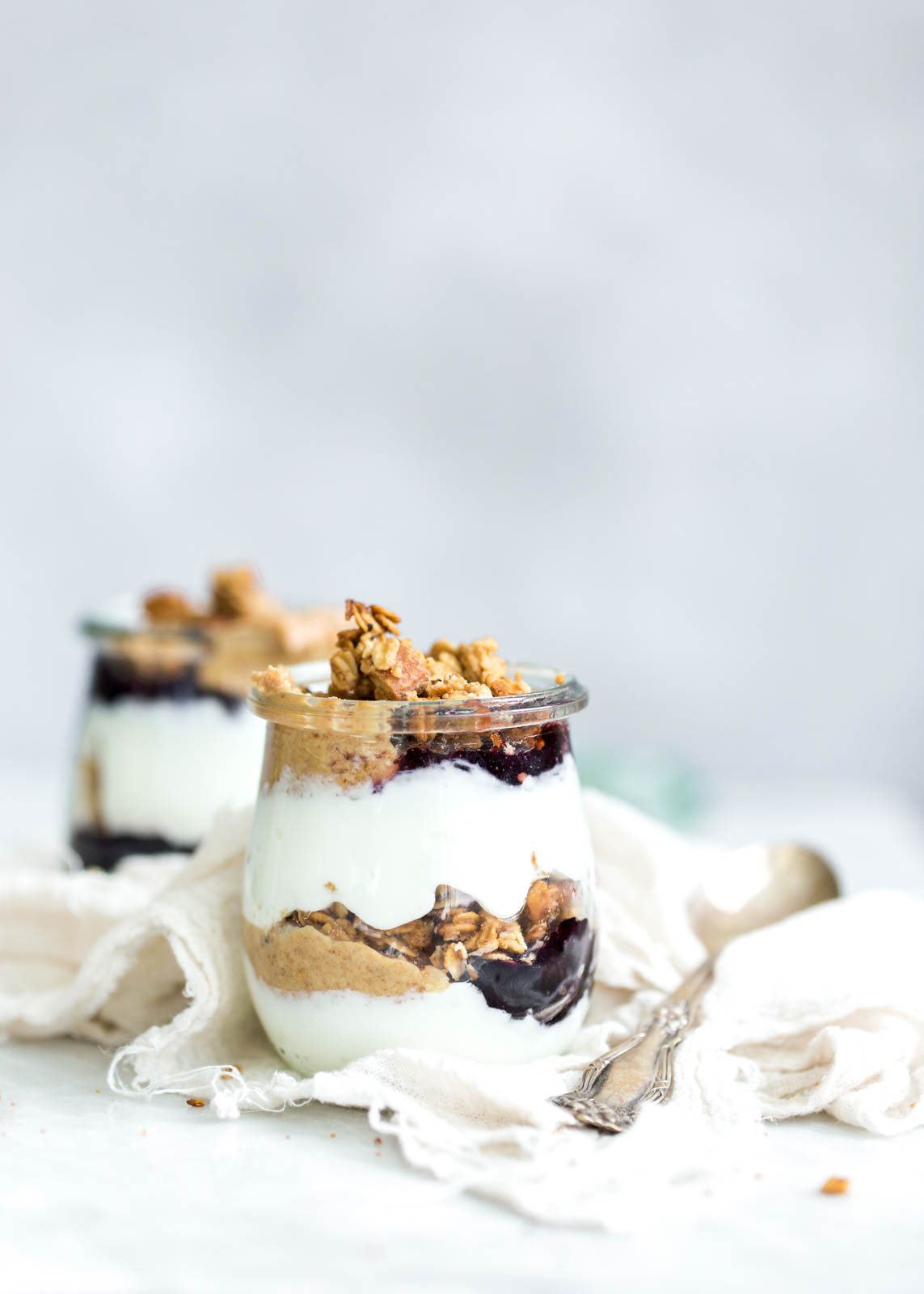 Peanut Butter and Jelly Yogurt Parfaits made with homemade peanut butter and honey granola and protein-packed Greek yogurt. YUM!