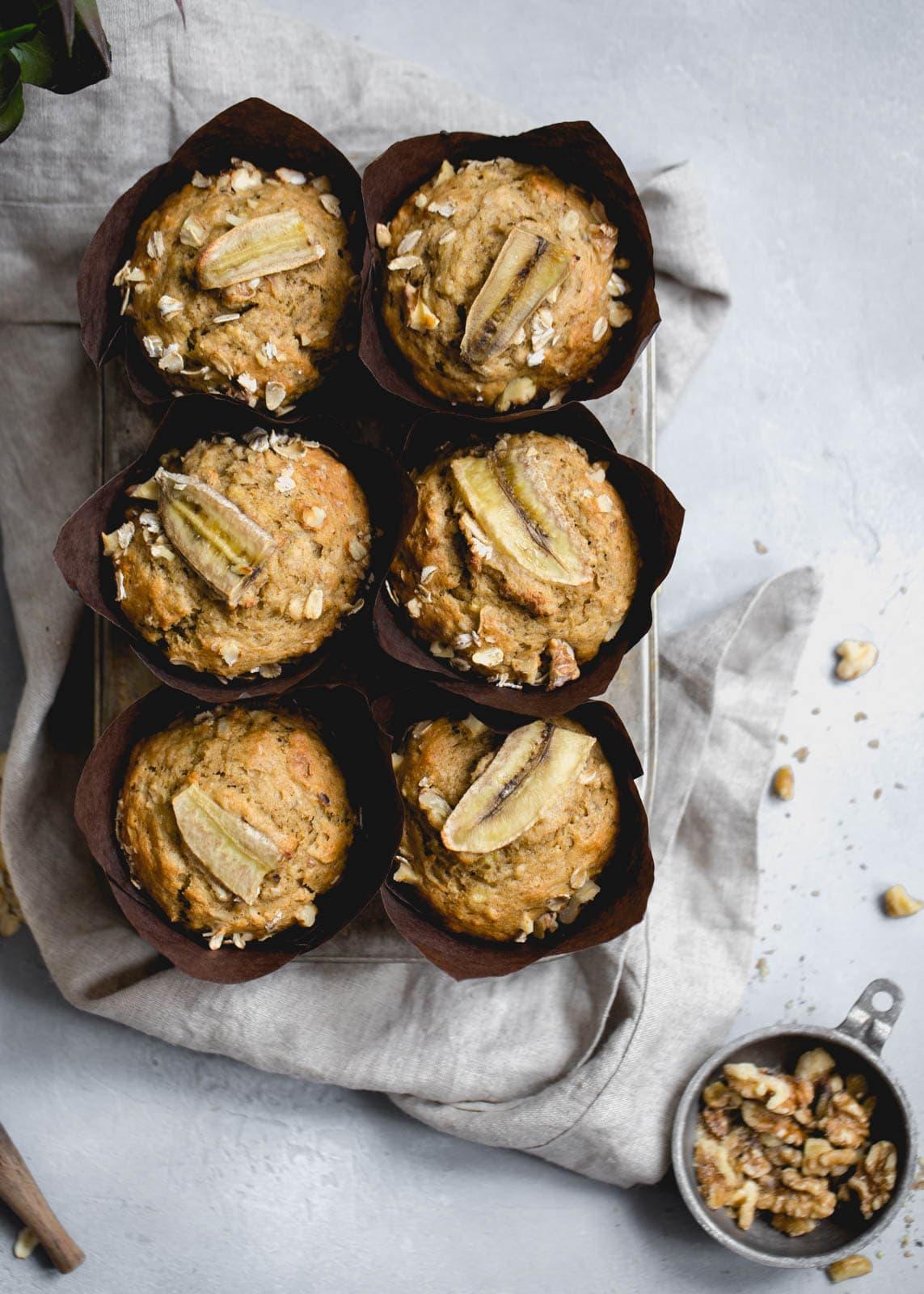 whole wheat banana muffins next to walnuts