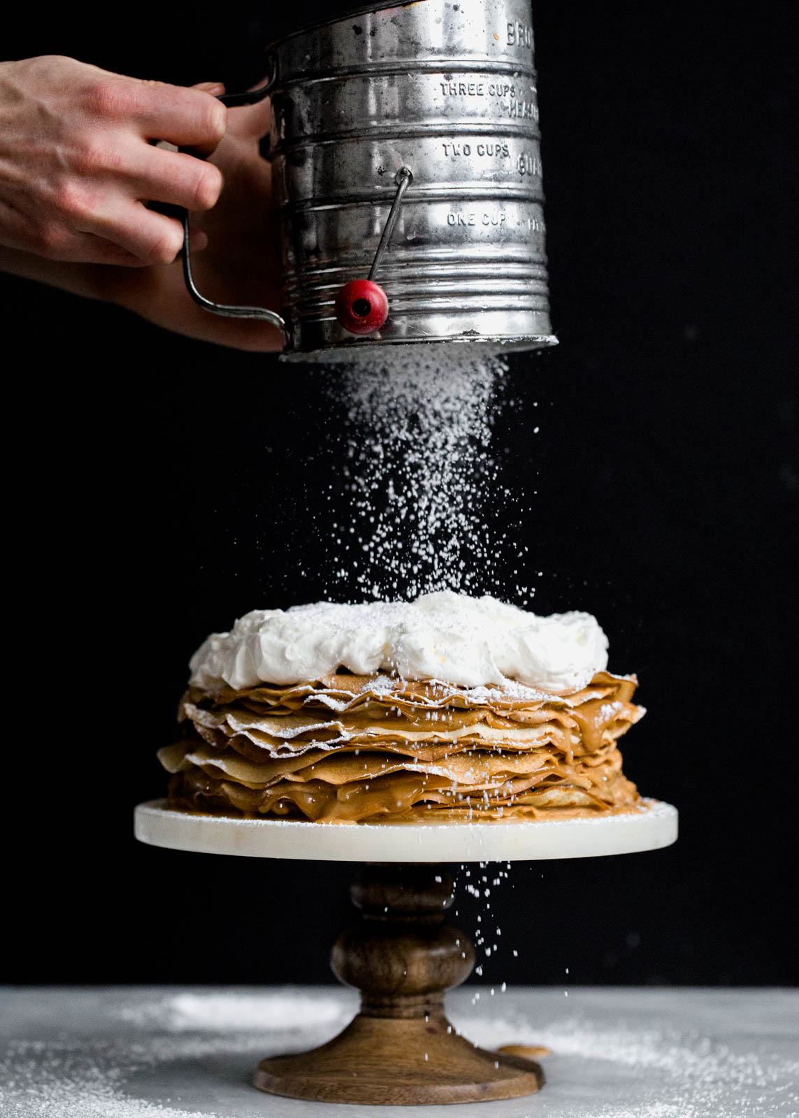 Layer after layer of banana crepes and dulce de leche, topped with whipped cream and bananas foster!