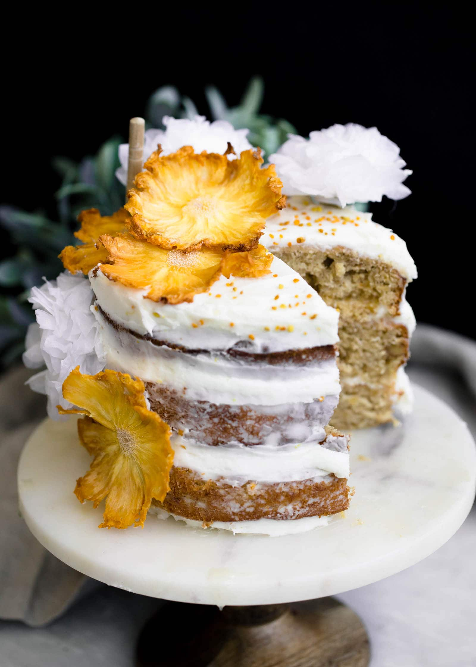 sliced Hummingbird Cake on cake stand