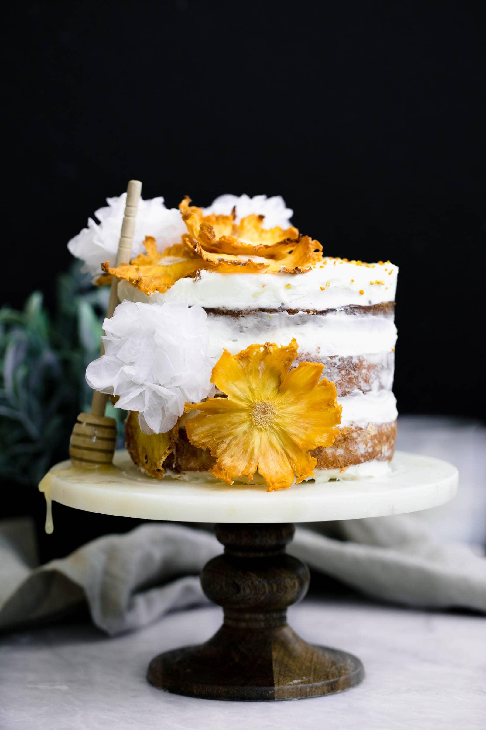 Hummingbird Cake on cake stand with honey
