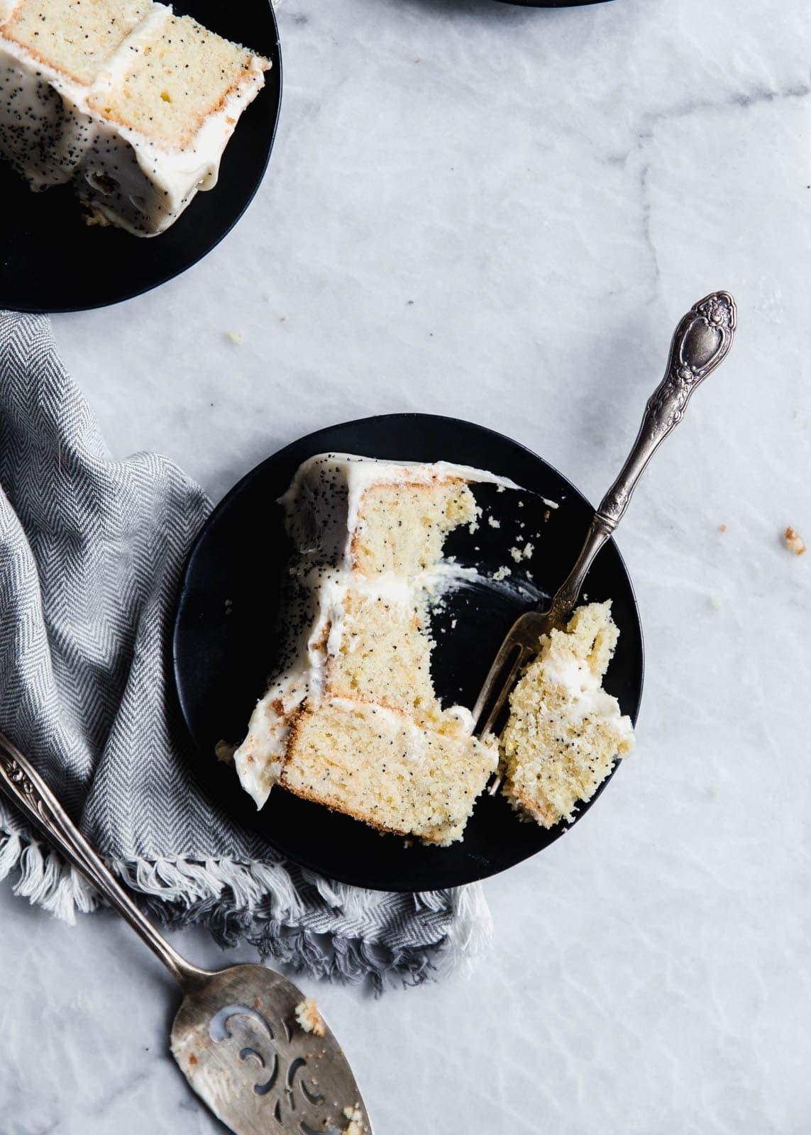 slice of lemon poppy seed cake on plate