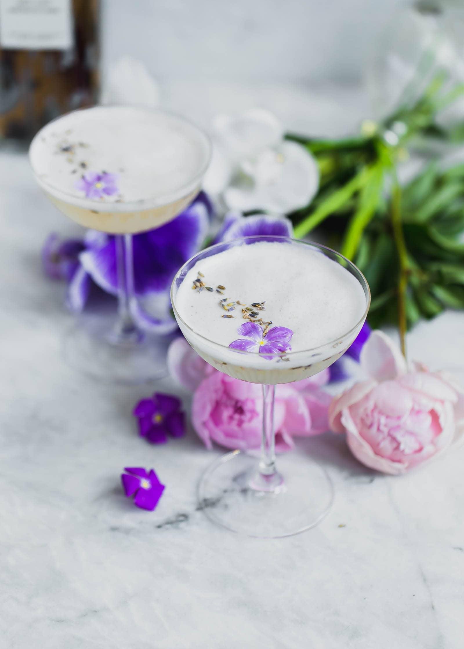 Lavender Coconut Vodka Sours topped with violets