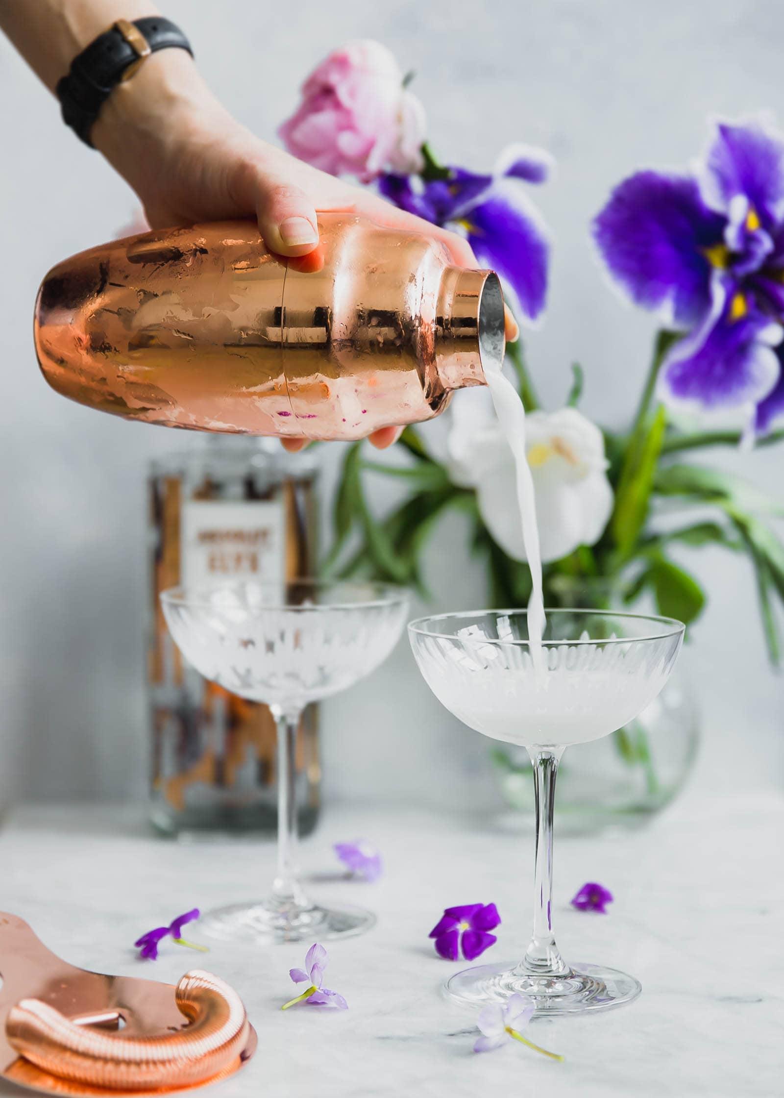 pouring Lavender Coconut Vodka Sour into a glass