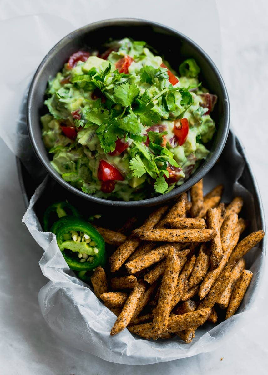 """Secret ingredient alert! This Ultimate Skinny Guacamole is lighter and healthier, yet just as creamy and delicious. You'll never eat """"regular"""" guac again!"""