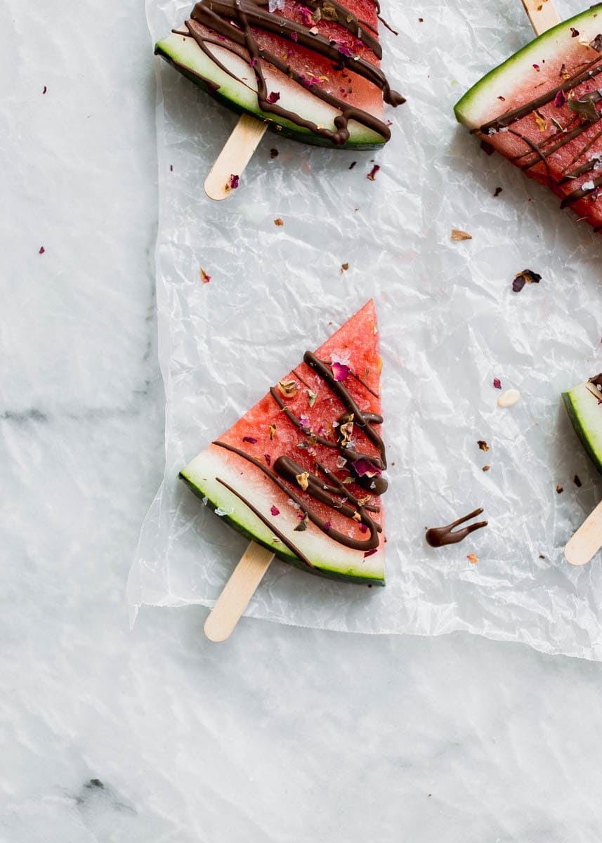 Low in sugar and totally refreshing, these fresh watermelon popsicles drizzled with chocolate and sea salt are the perfect treat on a hot summer's day!