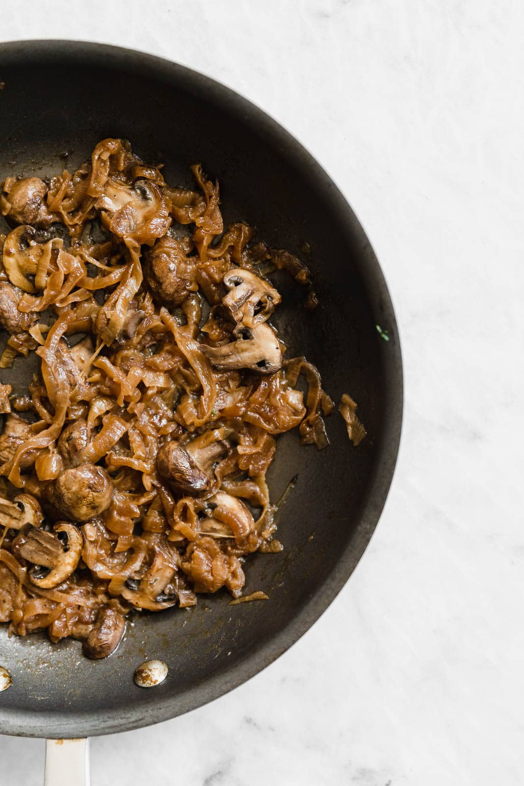 caramelized onions and mushrooms in a skillet