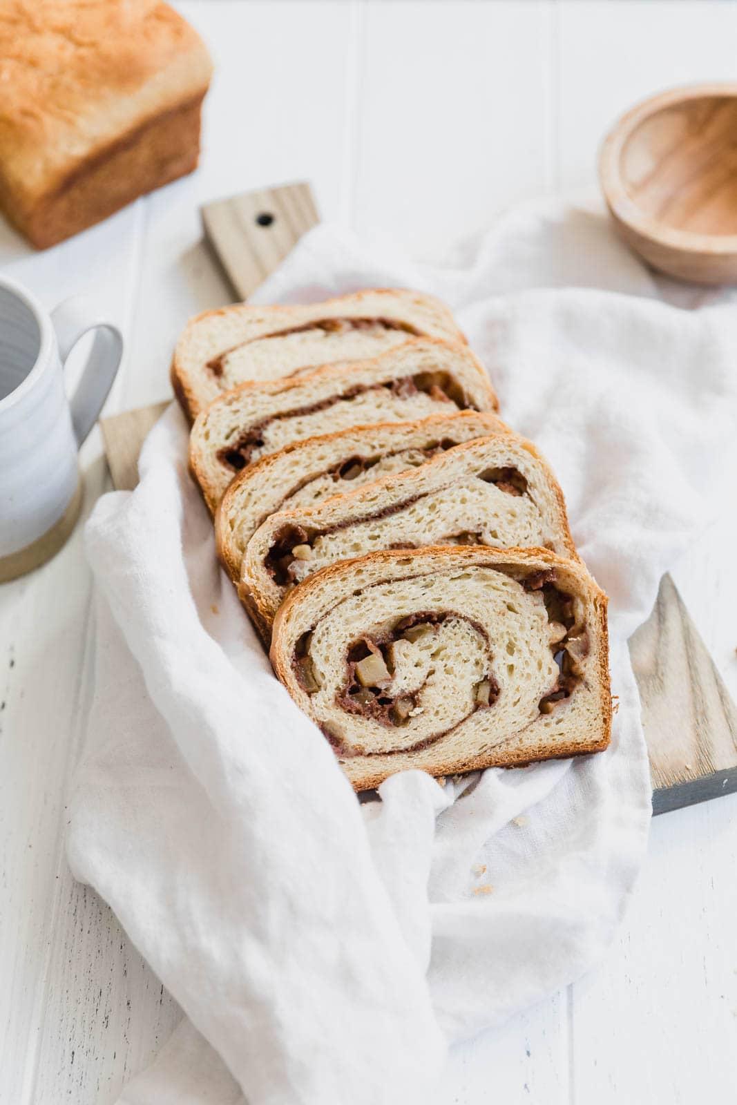 apple cinnamon bread slices on a towel