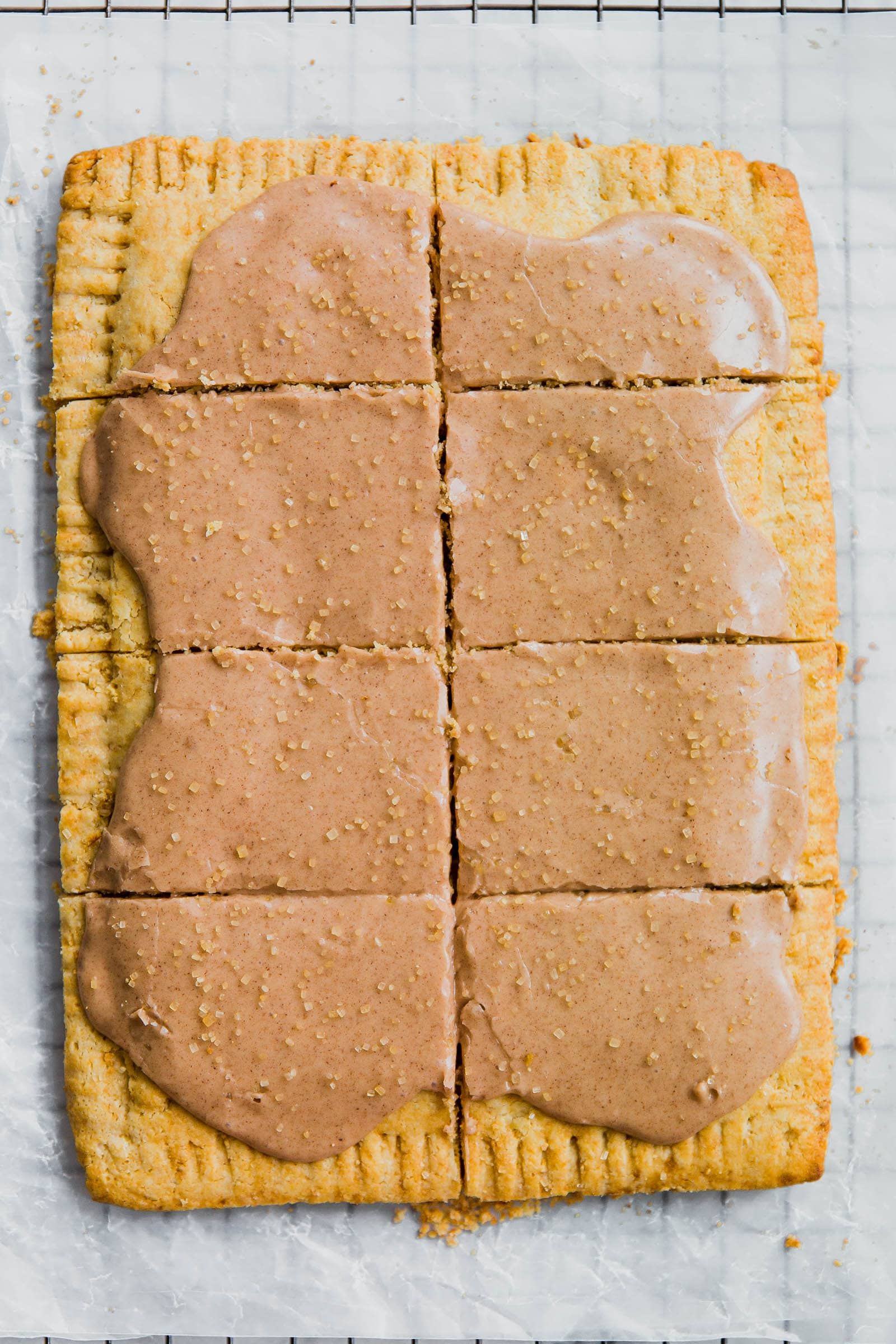 A giant buttery, flakey Grain Free Pumpkin Pop-Tart with a fall-spiced pumpkin filling and topped with a cinnamon maple glaze!