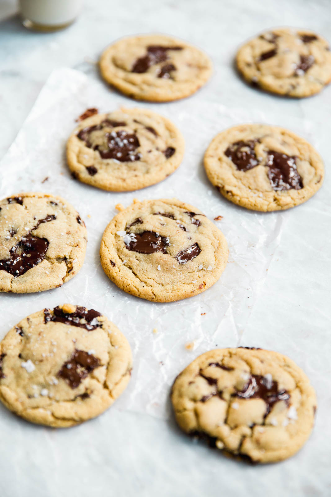 Hands down The Best Tahini Chocolate Chip Cookies In The World. Golden brown and baked to perfection with that addicting bakery-style chewiness and giant chunks of chocolate!