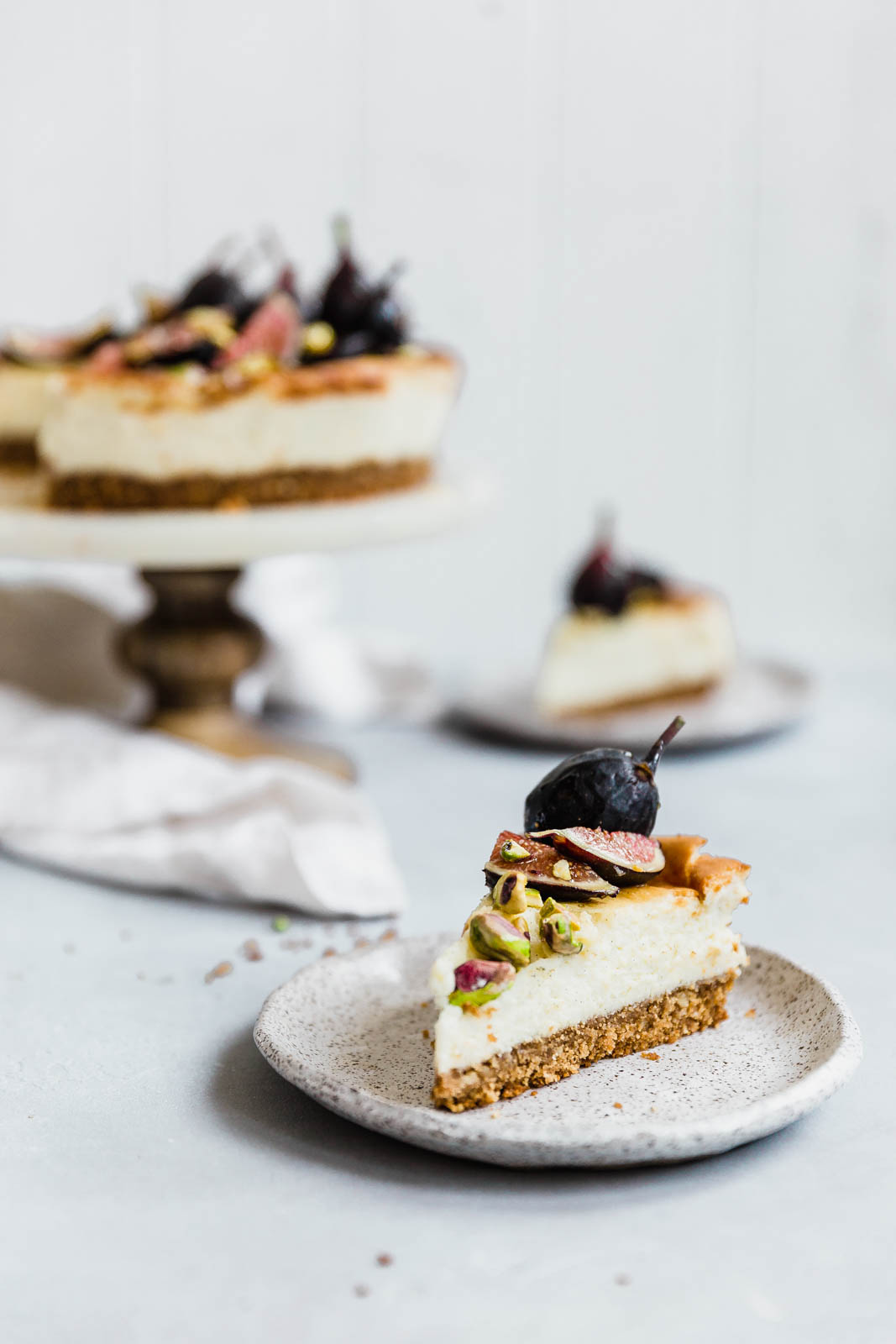 Classic gets an update with this smooth, creamy Vanilla Bean Cheesecake jazzed up with fresh figs, pistachios, and honey.