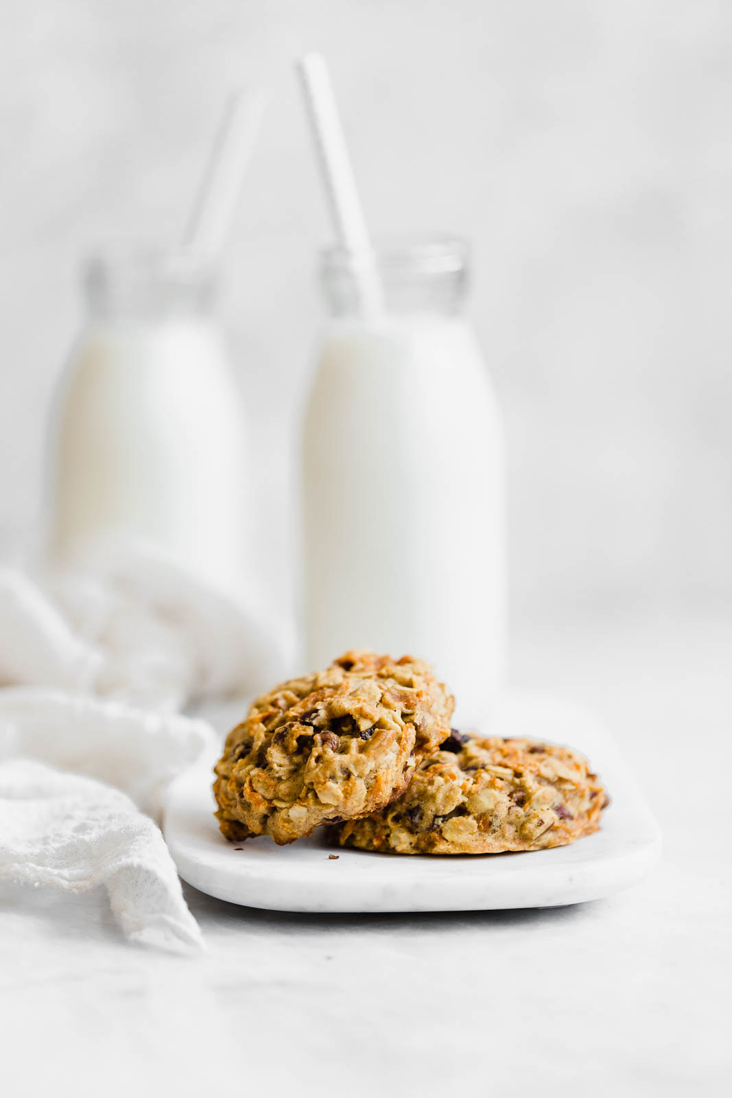 breakfast cookies on a plate with milk