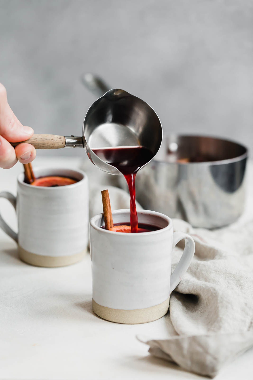 simple mulled wine recipe being poured into a mug