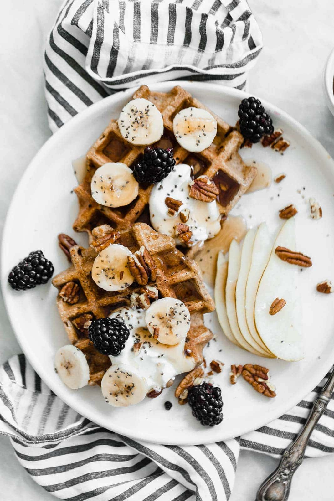 pumpkin spice waffles topped with yogurt and fruit