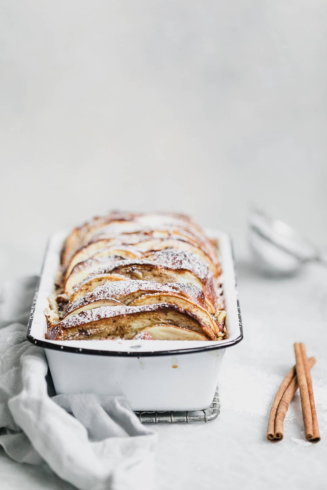 Baked Cinnamon Apple French Toast with cinnamon sticks