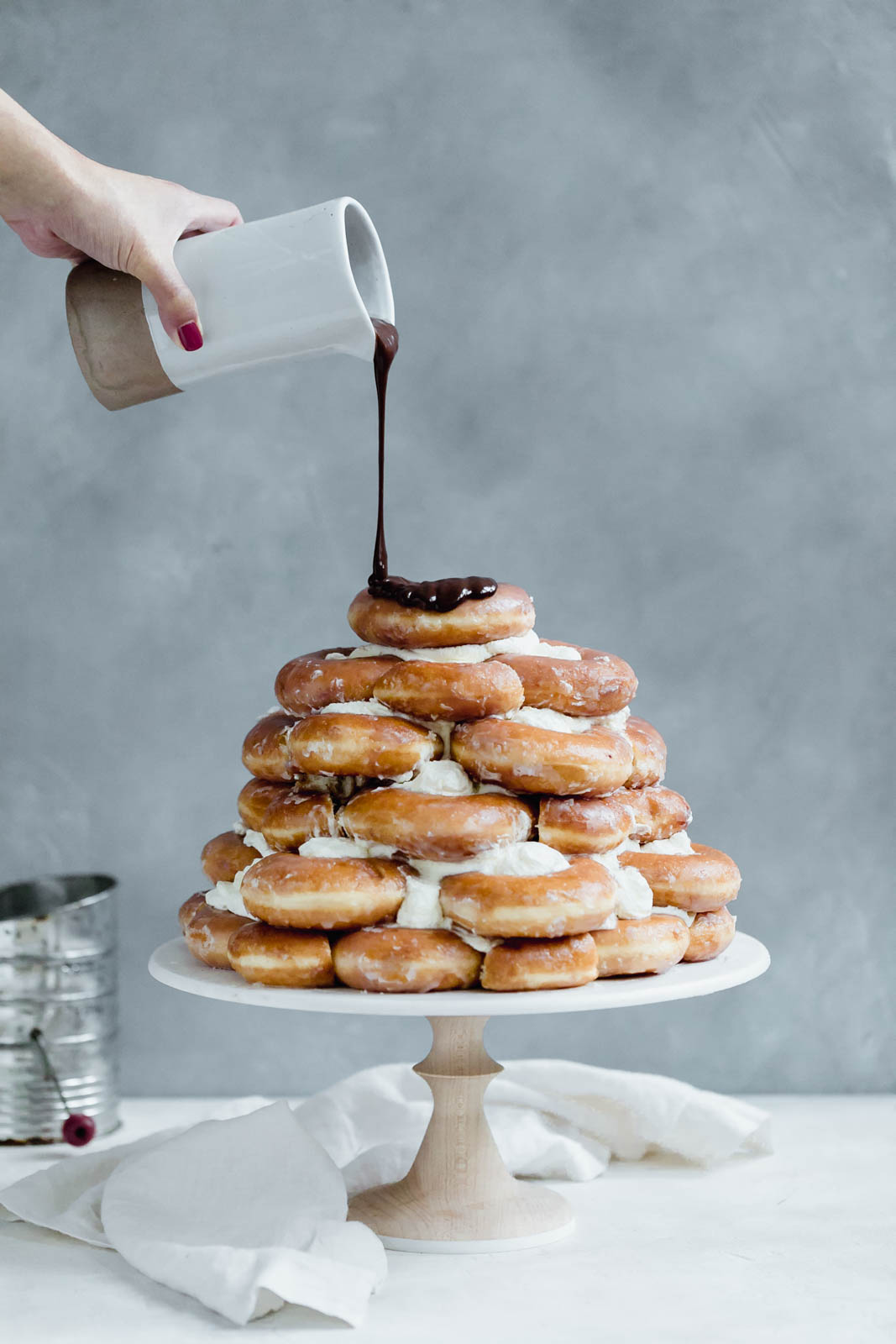 Krispy Kreme Doughnut Cake: a cake made entirely of Krispy Kreme doughnuts and drizzled with chocolate fudge sauce. I've died and gone to heaven.