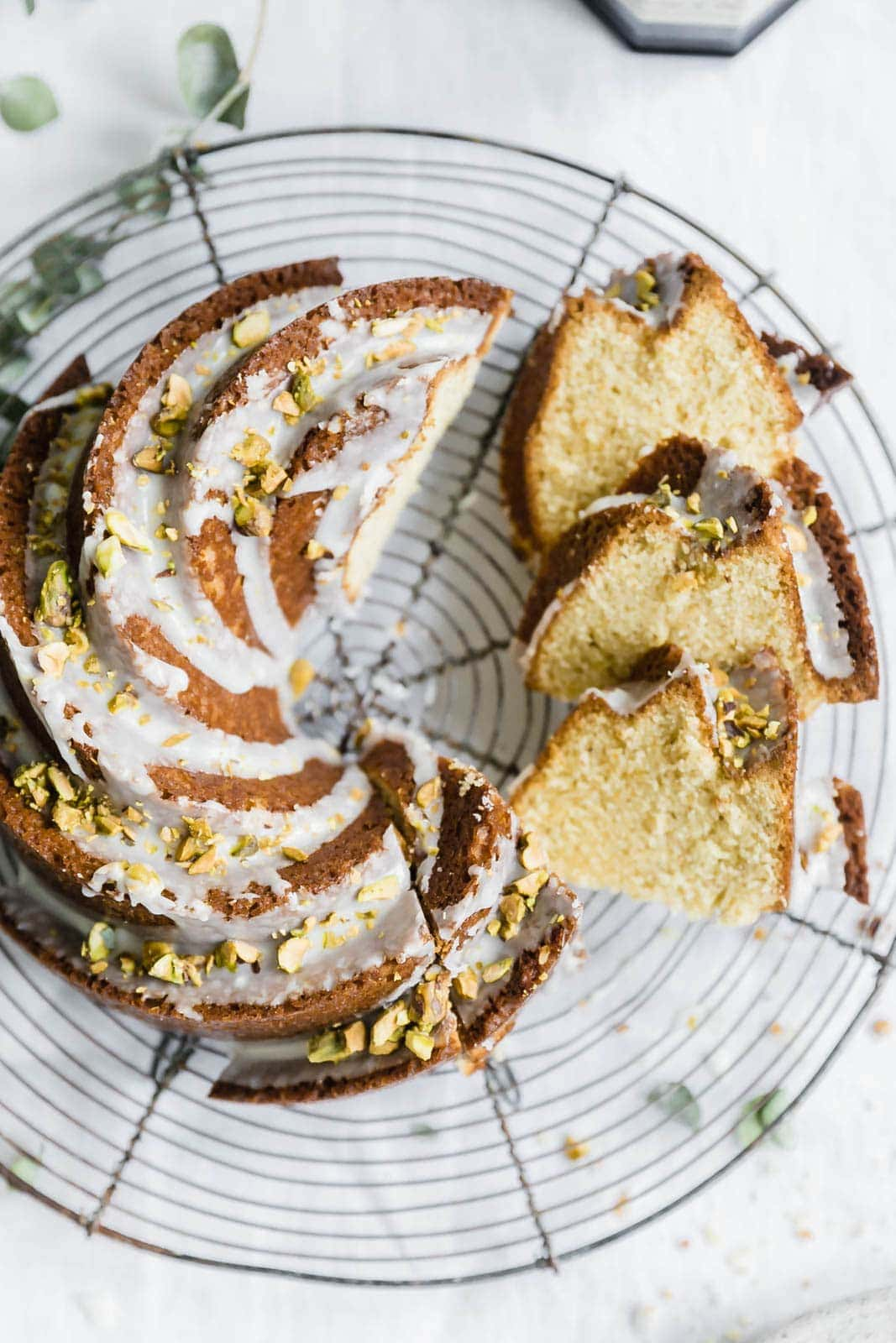 A super moist olive oil cake with pistachios and lemon makes for a luxurious weekend treat. The olive oil imparts the most delicious flavor!