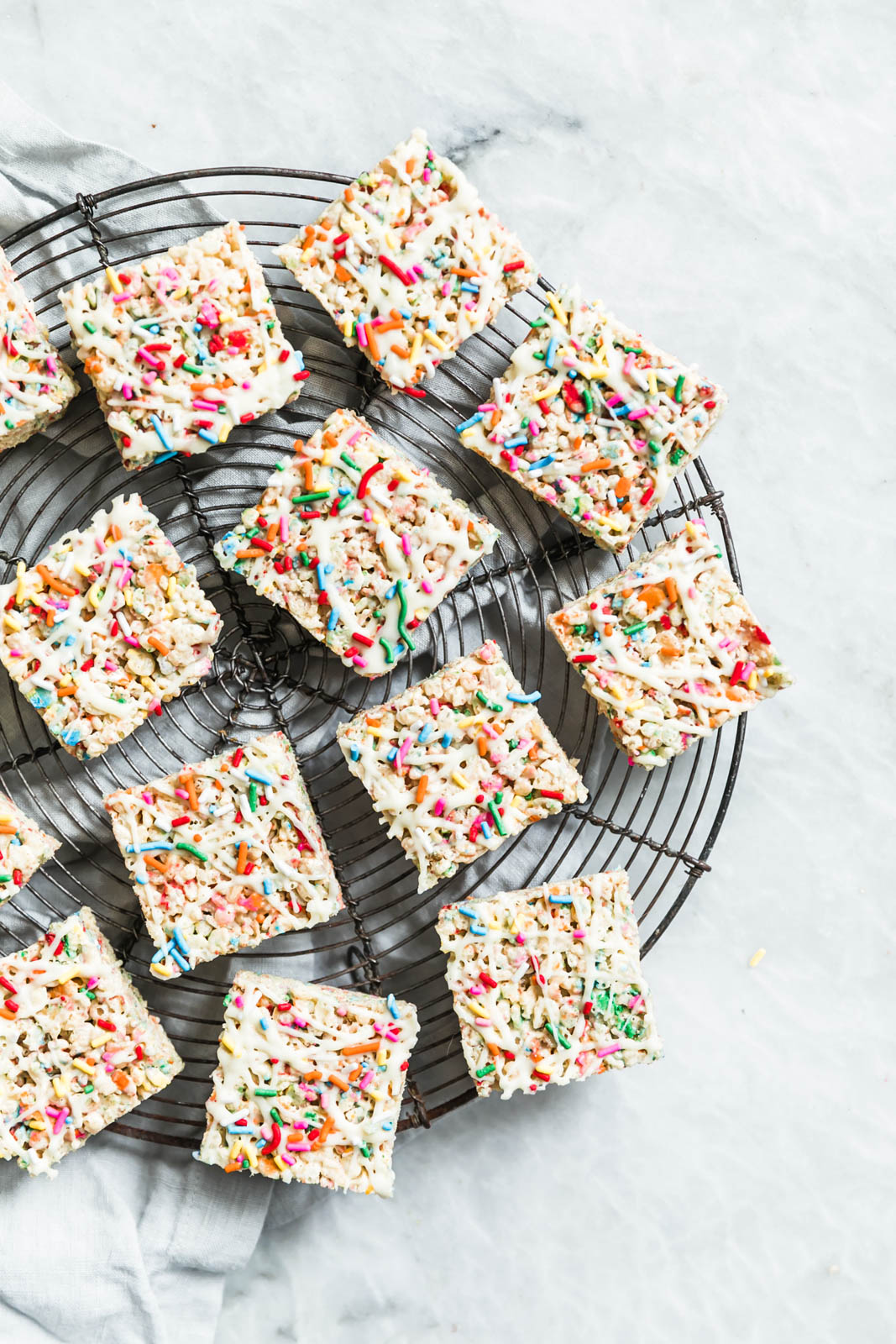 The easiest, prettiest White Chocolate Funfetti Rice Krispie Treats ever! Made with only 5 ingredients, these babies come together in just minutes!