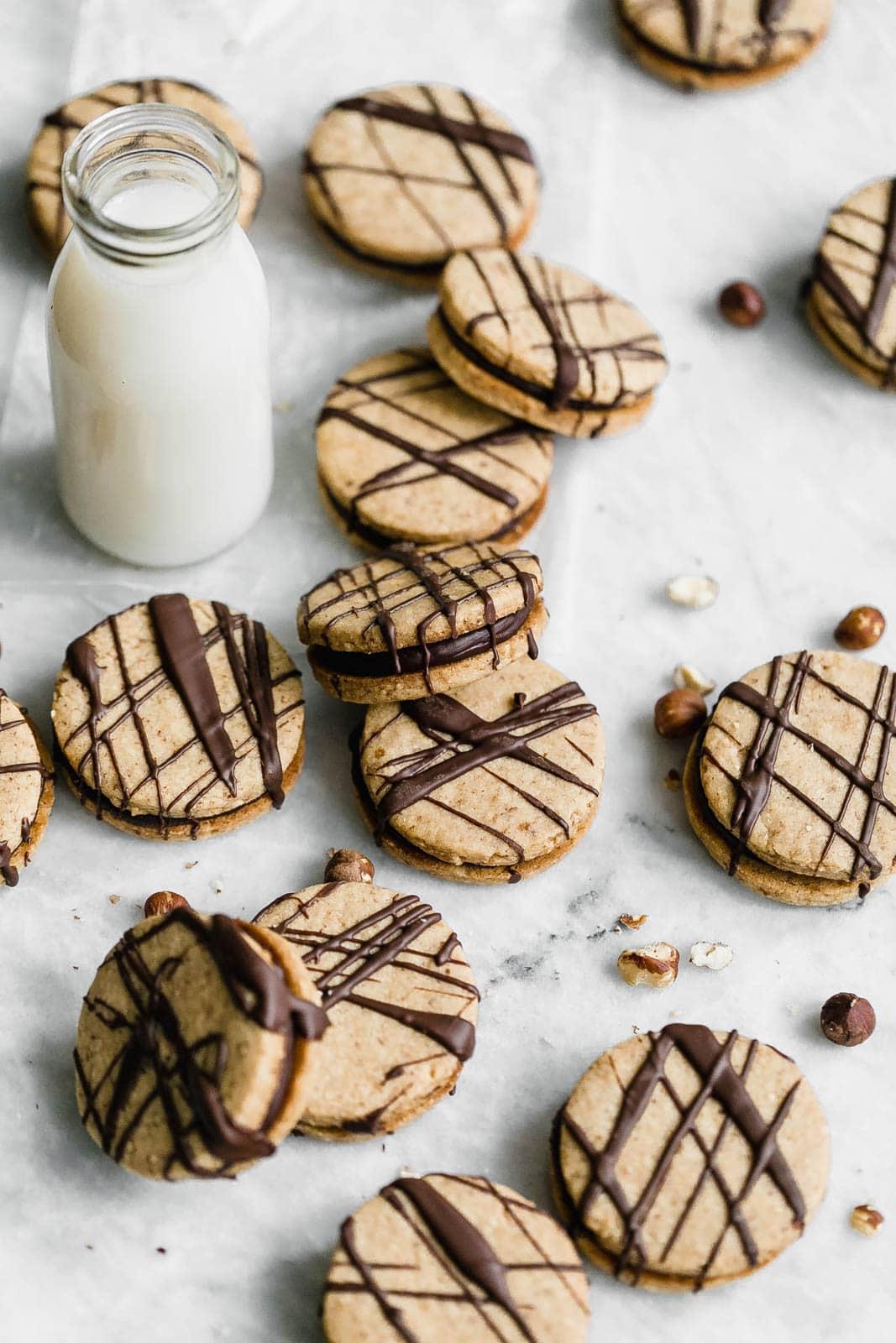 Hazelnut Espresso Sandwich Cookies with glass of milk