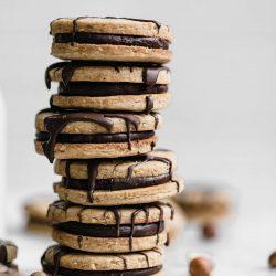 Hazelnut Espresso Sandwich Cookies: a perfect treat of sinful chocolate ganache sandwiched between two hazelnut espresso cookies.