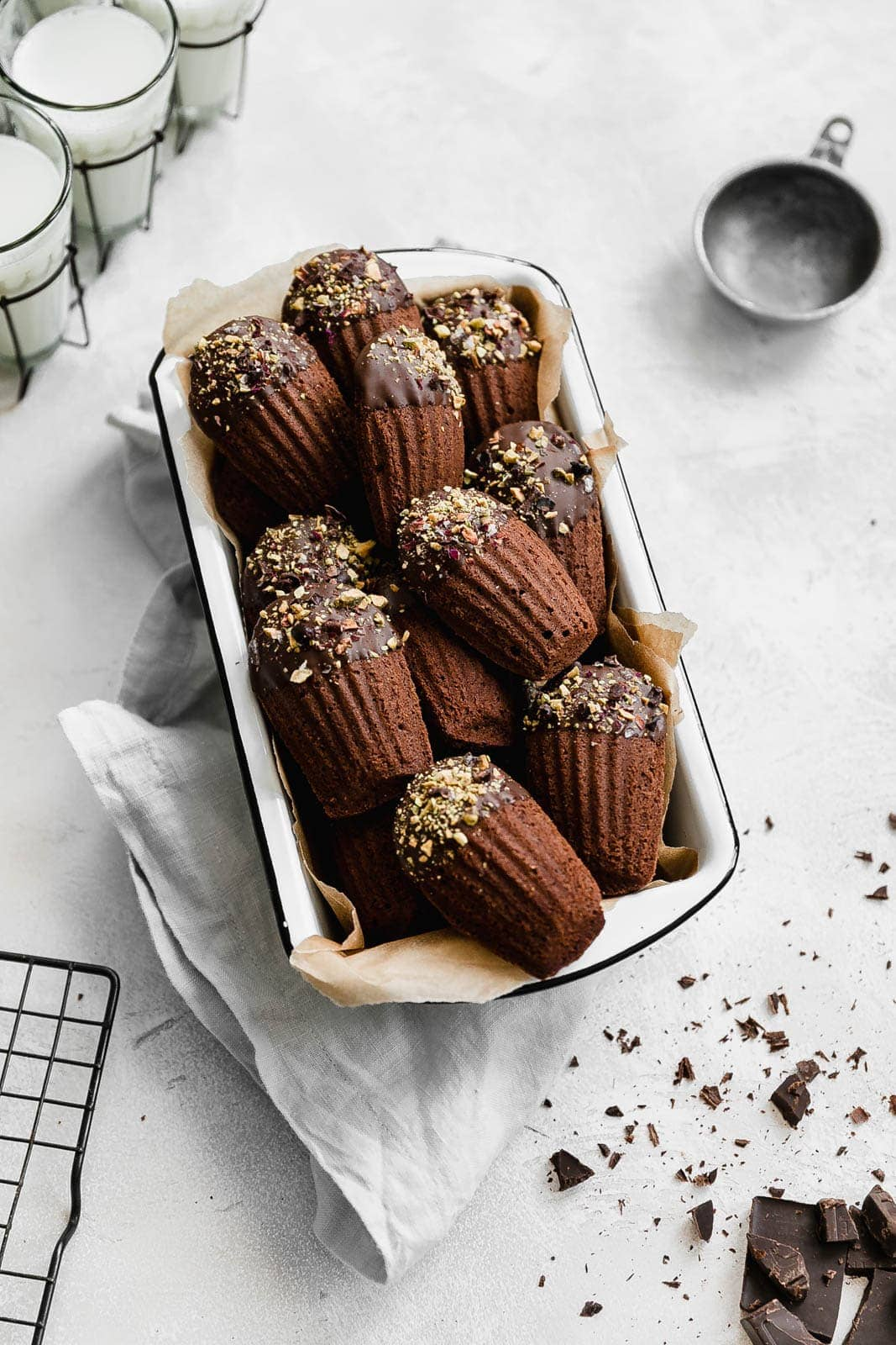 Simple and elegant, these chocolate dipped Chocolate Madeleines are almost too pretty to eat! But only almost, because they're also too good NOT to eat :)
