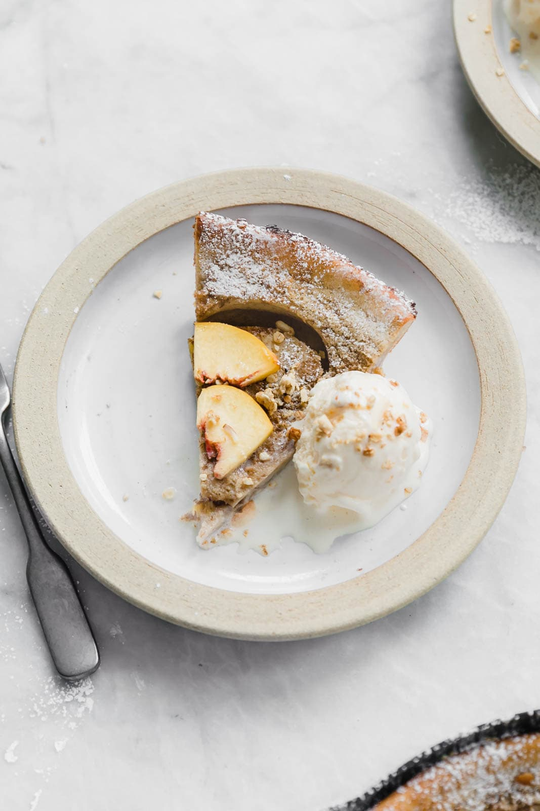 A deliciously epic bourbon brown butter peach dutch baby topped with granola, fresh peaches, and vanilla ice cream! Perfect for a lazy Sunday morning :)
