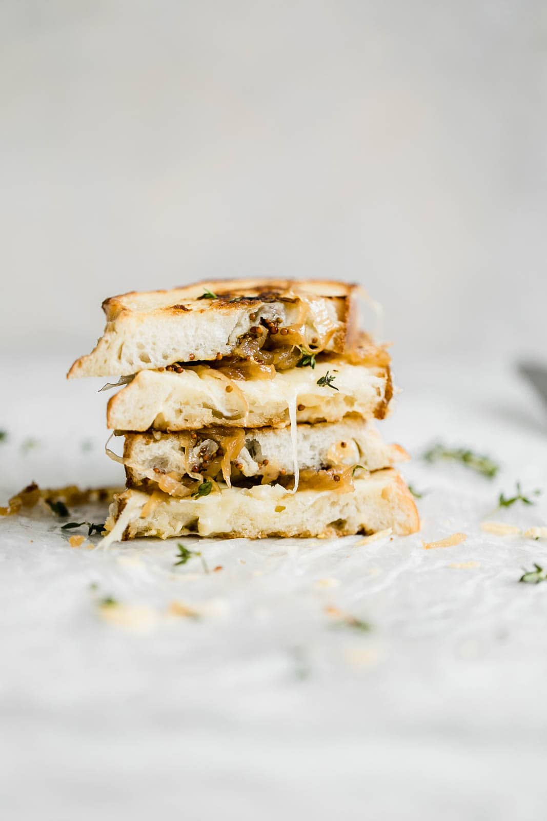 stack of Caramelized Onion, Whole Grain Mustard, and Gruyere Grilled Cheese sandwiches