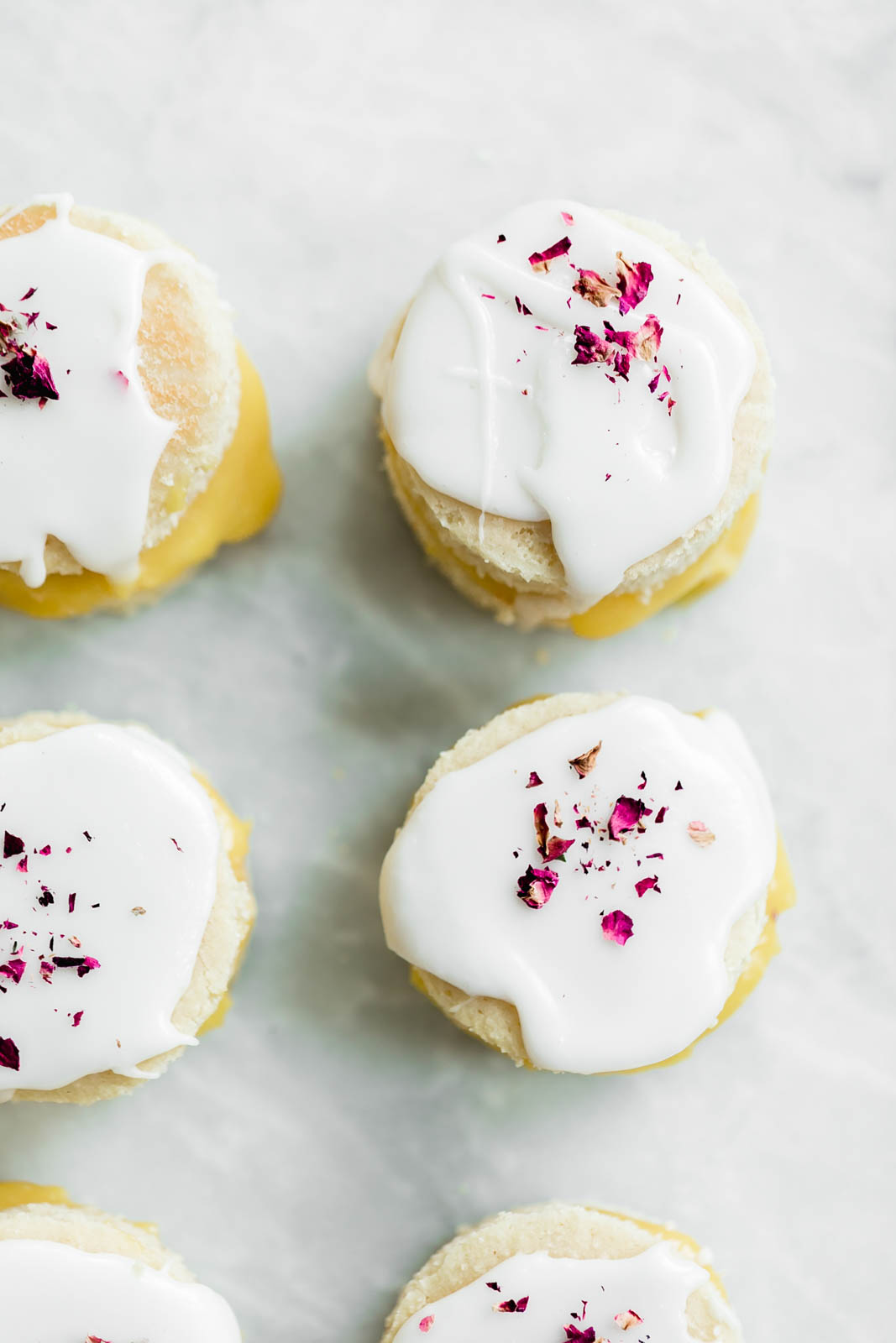 Coconut Lemon Curd Petit Fours: homemade lemon curd sandwiched between two coconut flour cakes and topped with lemon icing. HELLO SPRING!