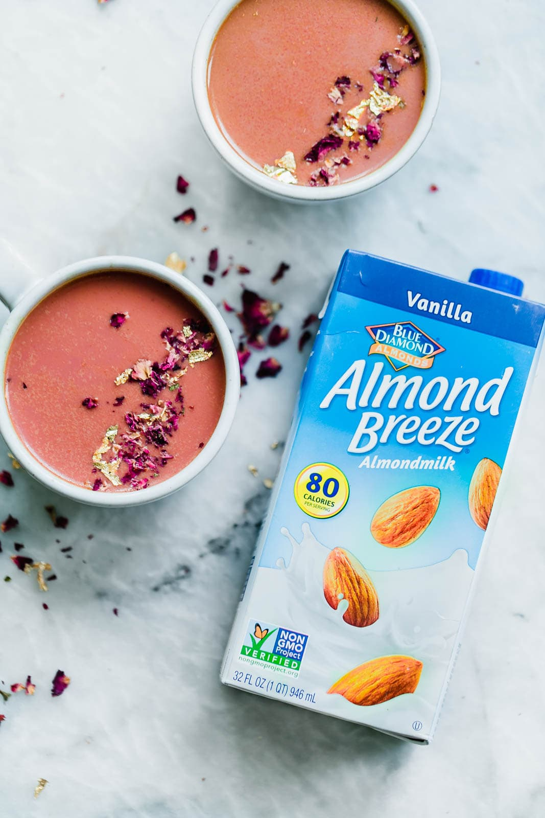 Elevate your bedtime routine with this Pink Moon Milk fit for a princess. Made with vanilla almondmilk, beetroot, turmeric, agave, dried rose hips, and edible gold.