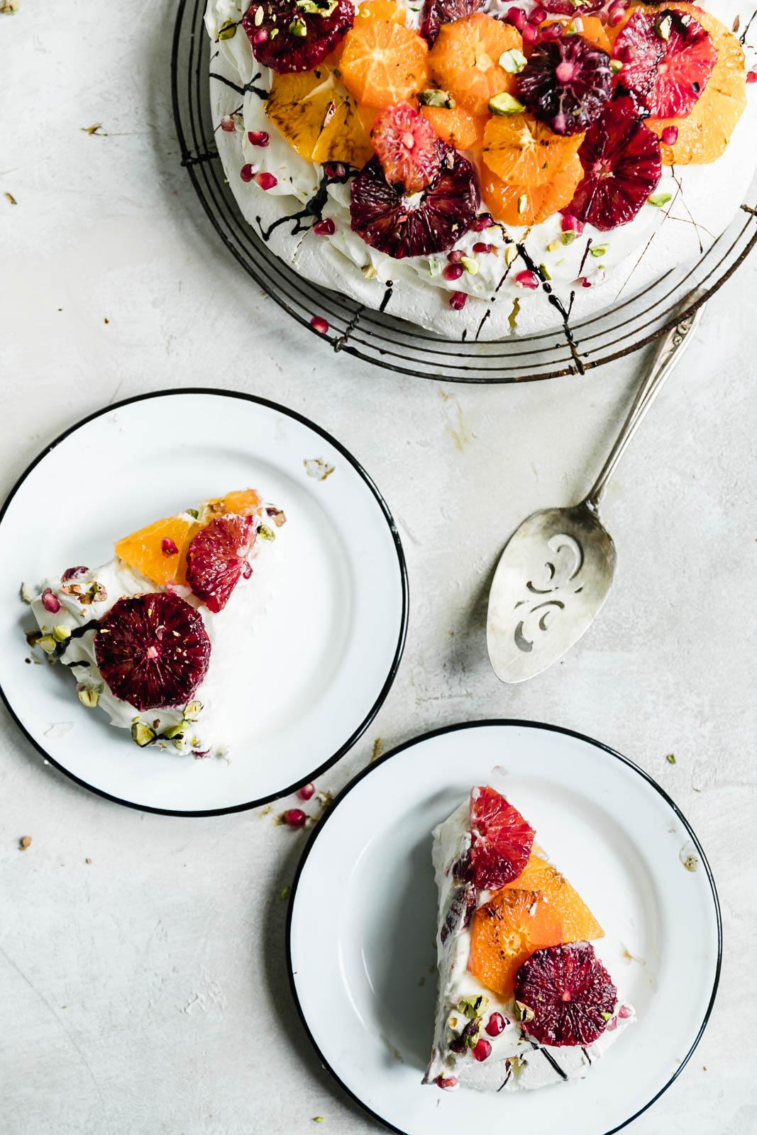 slice of citrus pavlova cake on a plate